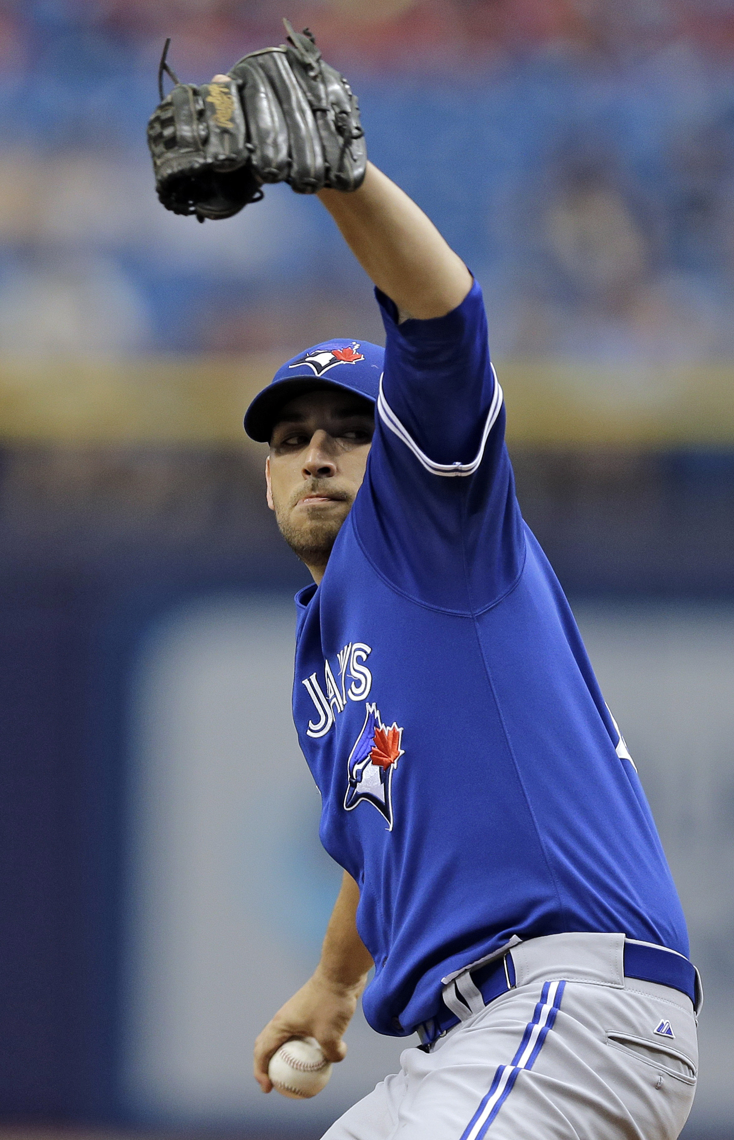 Toronto Blue Jays pitcher Marco Estrada winds up to throw against the Tampa Bay Rays during the first inning of a baseball game, Wednesday, June 24, 2015, in St. Petersburg, Fla.  (AP Photo/Chris O'Meara)