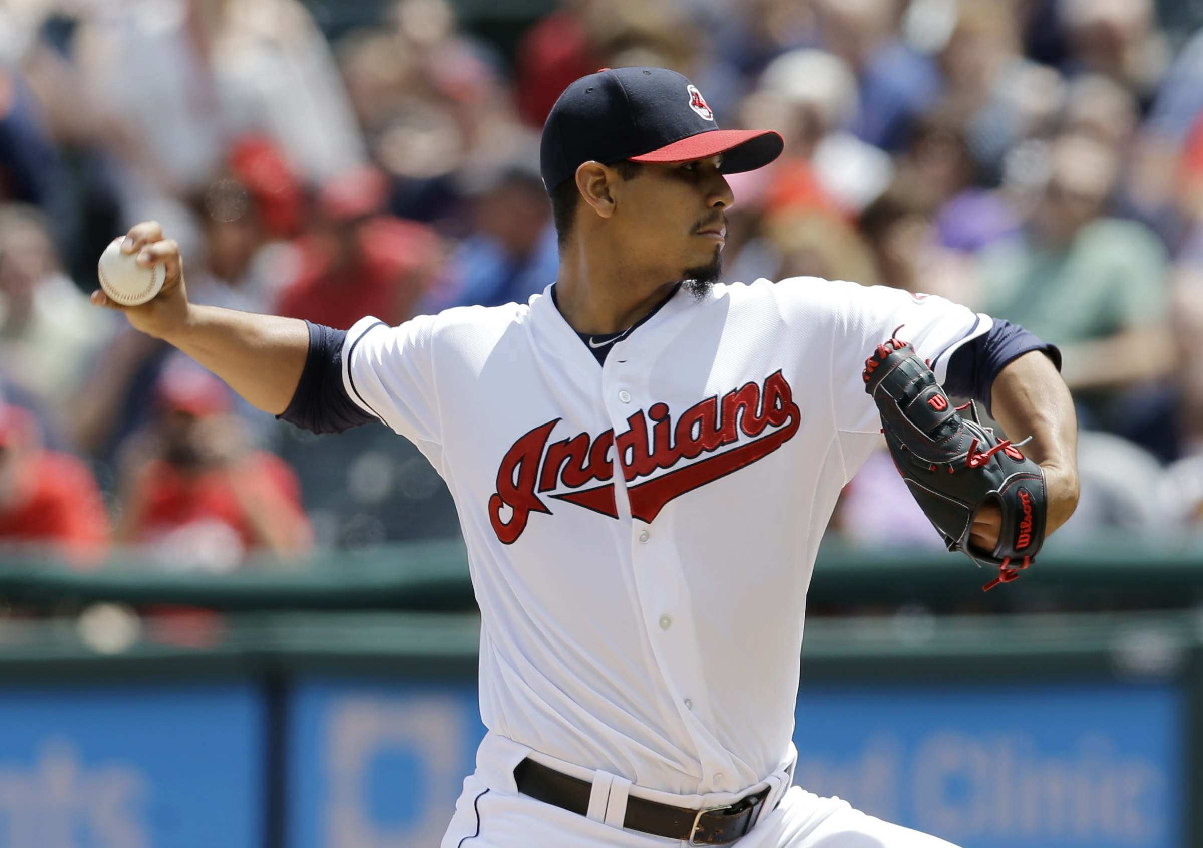 Cleveland Indians starting pitcher Carlos Carrasco delivers in the first inning of a baseball game against the Detroit Indians, Wednesday, June 24, 2015, in Cleveland. (AP Photo/Tony Dejak)