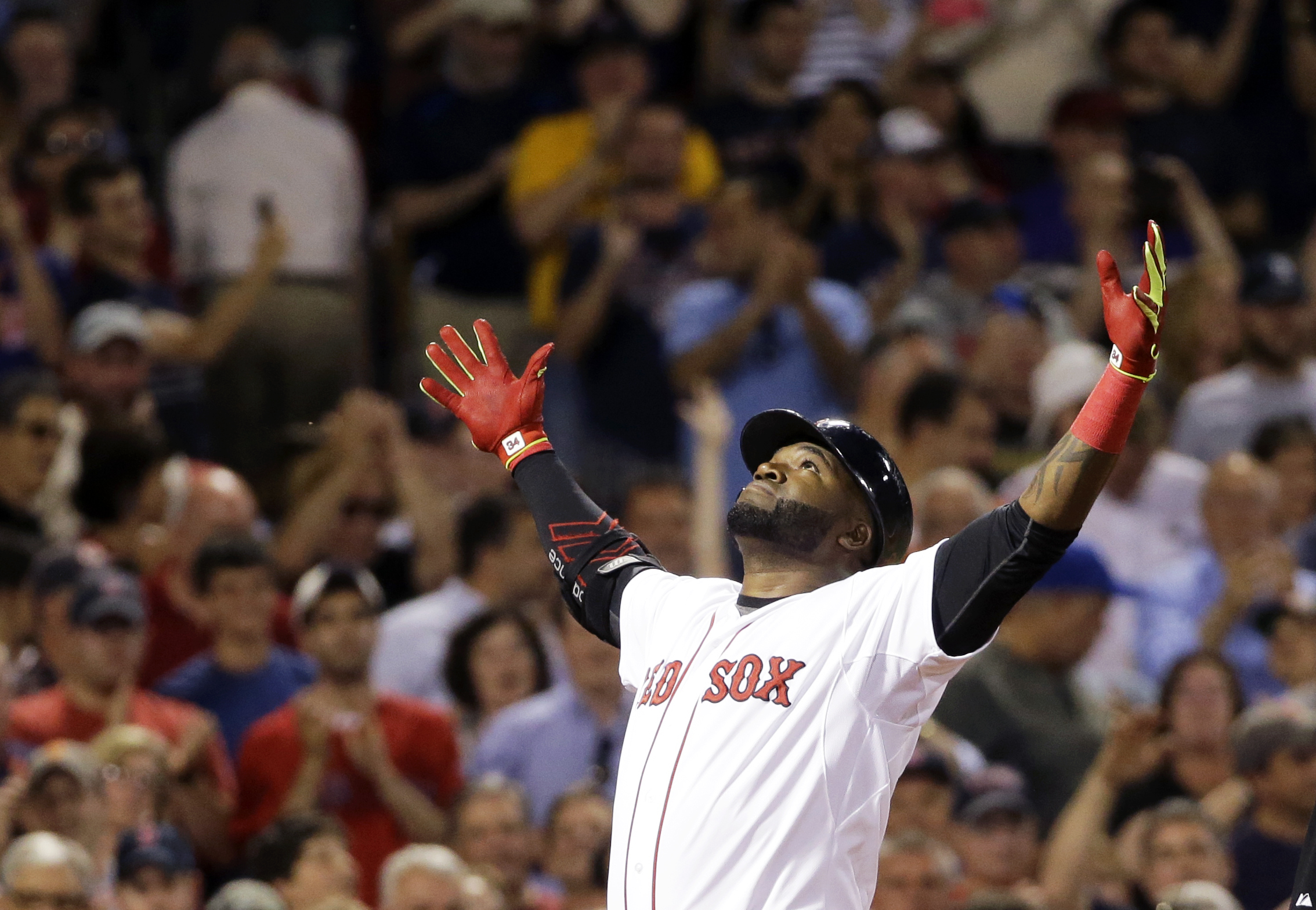 Boston Red Sox designated hitter David Ortiz reacts as he crosses the plate after hitting a two-run home run during the sixth inning of a baseball game against the Baltimore Orioles at Fenway Park, Wednesday, June 24, 2015, in Boston. (AP Photo/Elise Amen