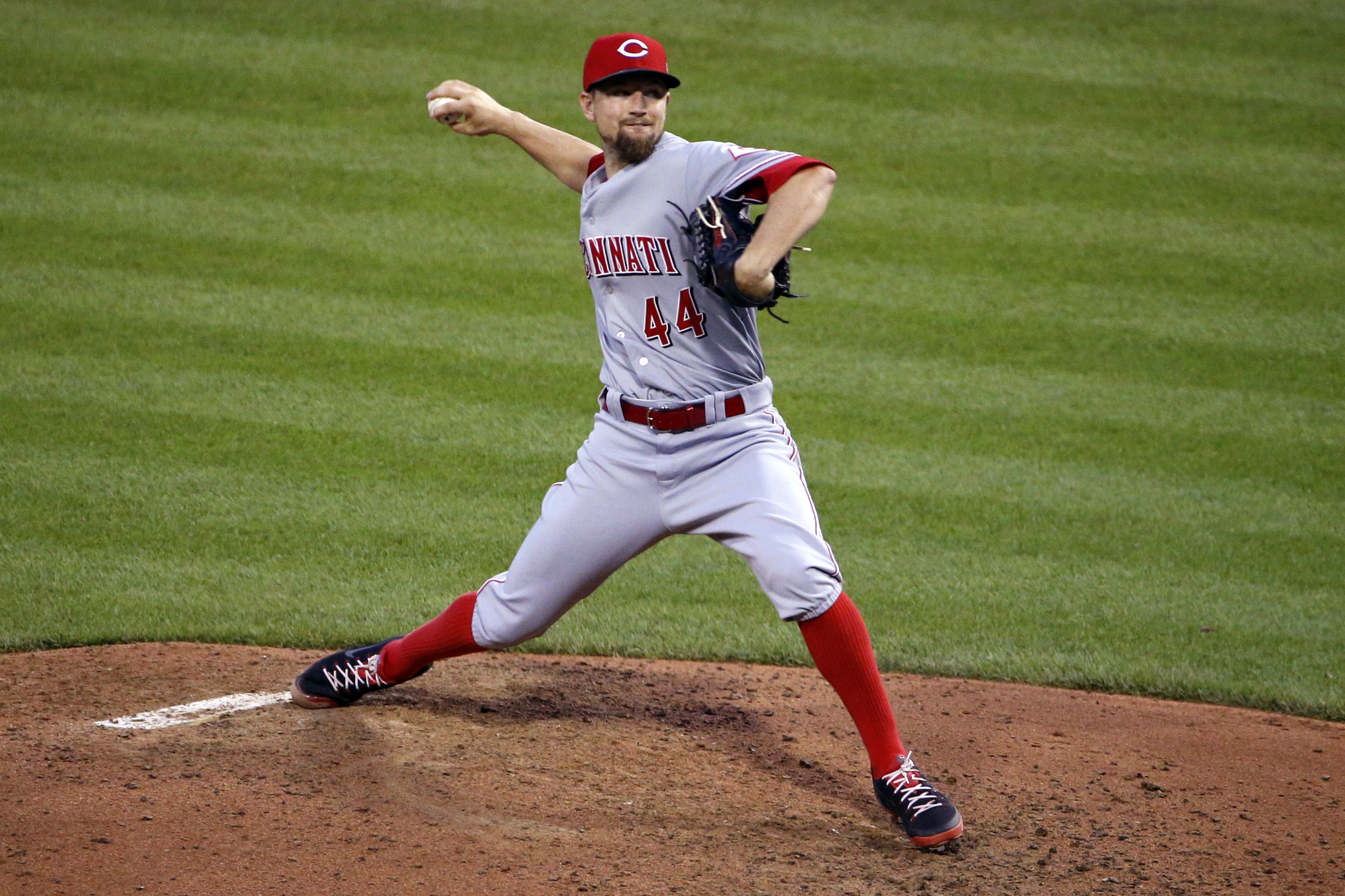 Cincinnati Reds starting pitcher Mike Leake (44) delivers during the fifth inning of a baseball game against the Pittsburgh Pirates in Pittsburgh, Wednesday, June 24, 2015. (AP Photo/Gene J. Puskar)