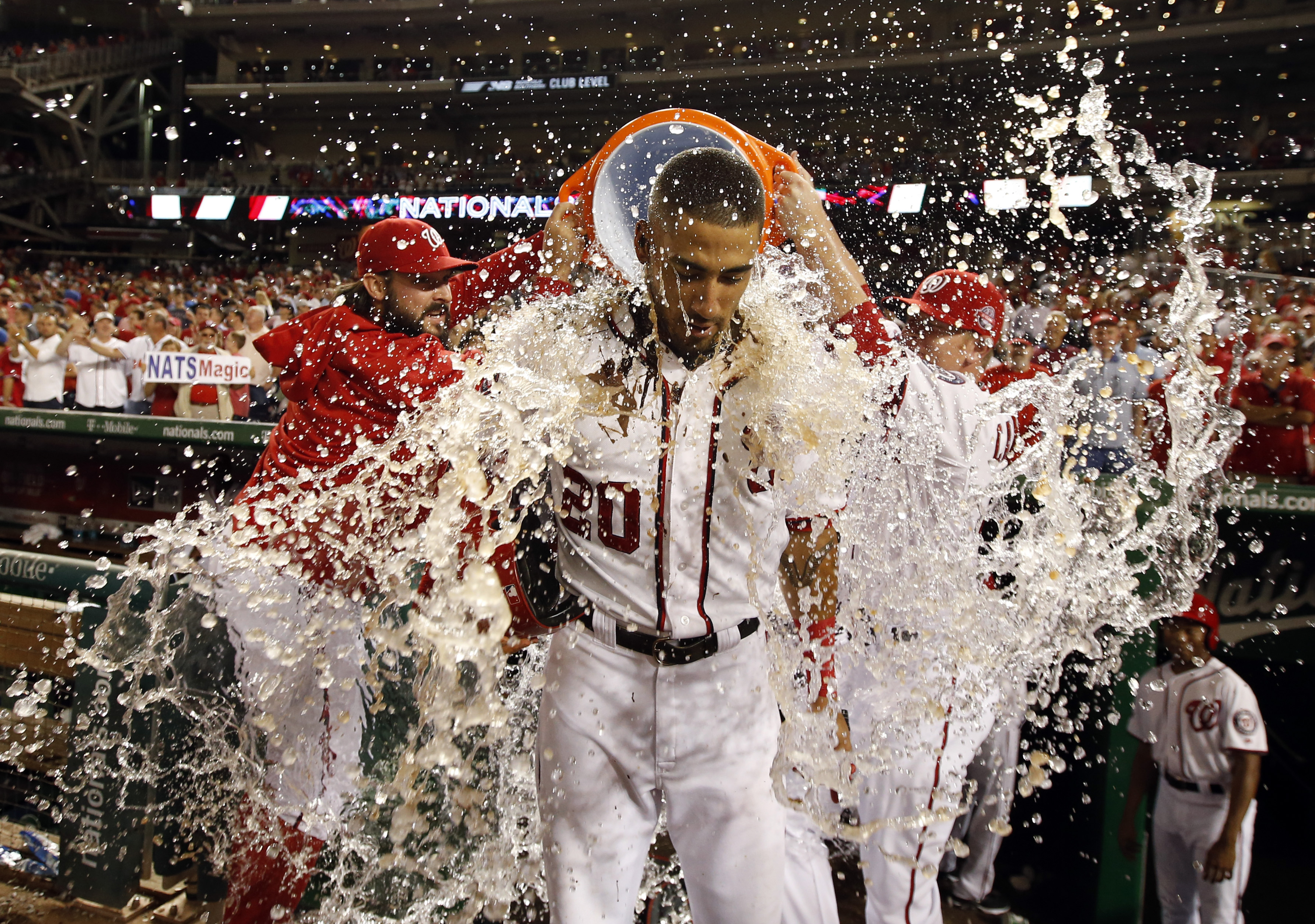 CORRECTS THAT DESMOND HIT SACRIFICE FLY, INSTEAD OF SINGLE - Washington Nationals' Ian Desmond is doused after the team's baseball game against the Atlanta Braves at Nationals Park, Wednesday, June 24, 2015, in Washington. Desmond hit a sacrifice fly to s