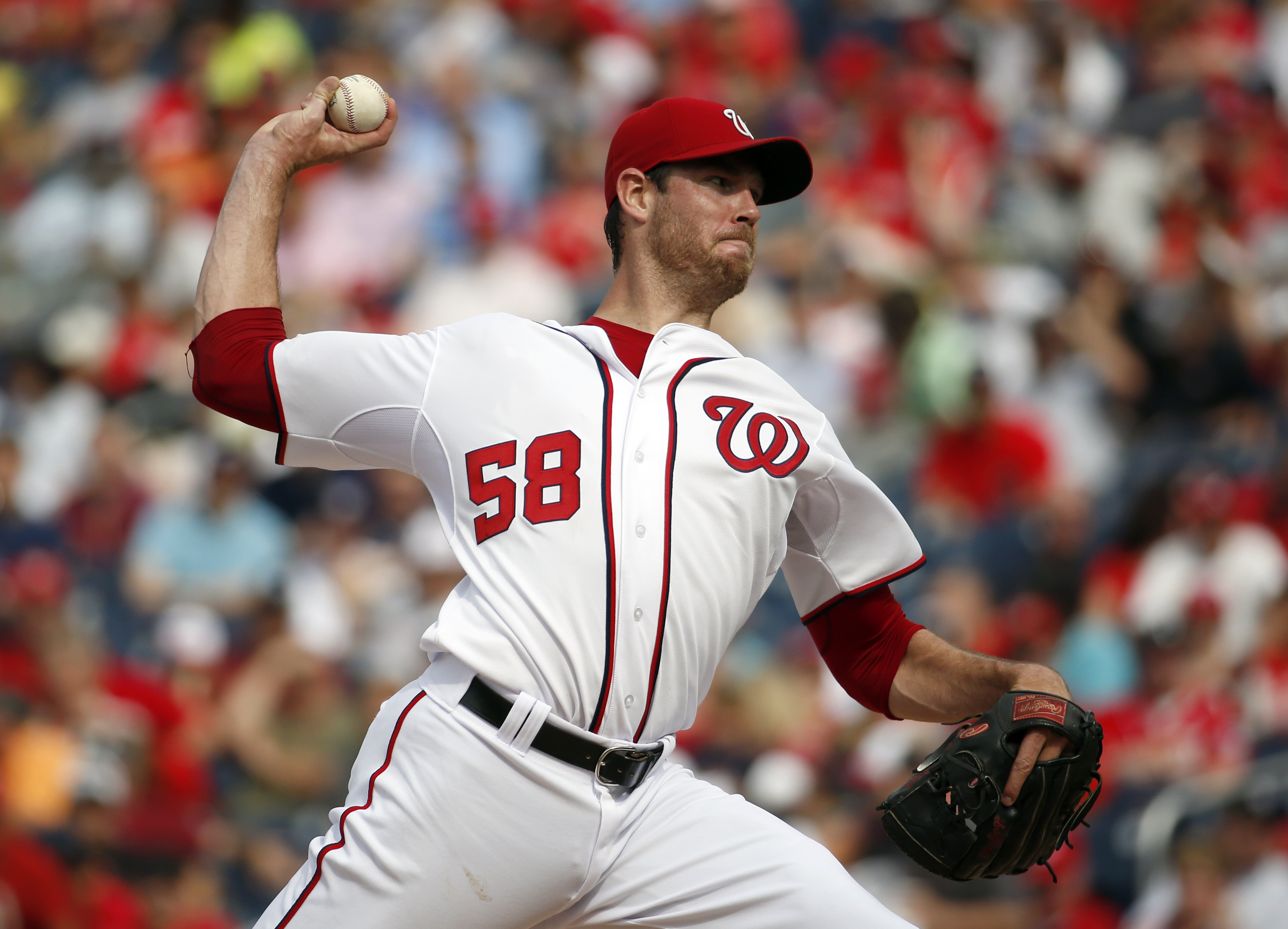 Washington Nationals starting pitcher Doug Fister throws during the third inning of a baseball game against the Atlanta Braves at Nationals Park, Thursday, June 25, 2015, in Washington. (AP Photo/Alex Brandon)