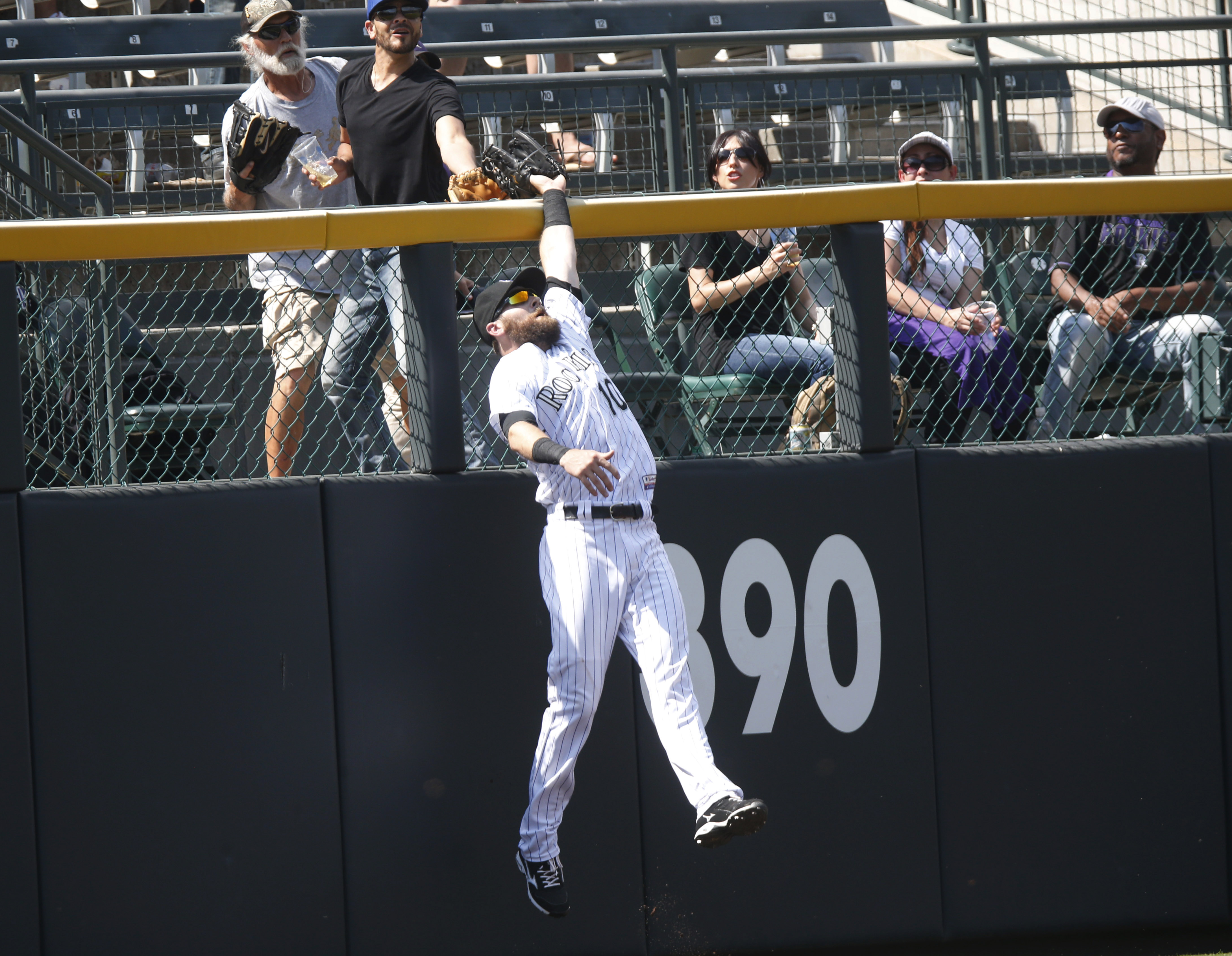 Colorado Rockies left fielder Ben Paulsen pulls in a fly ball hit by Arizona Diamondbacks' Chris Owings during the eighth inning of a baseball game Thursday, June 25, 2015, in Denver. Colorado won 6-4. (AP Photo/David Zalubowski)