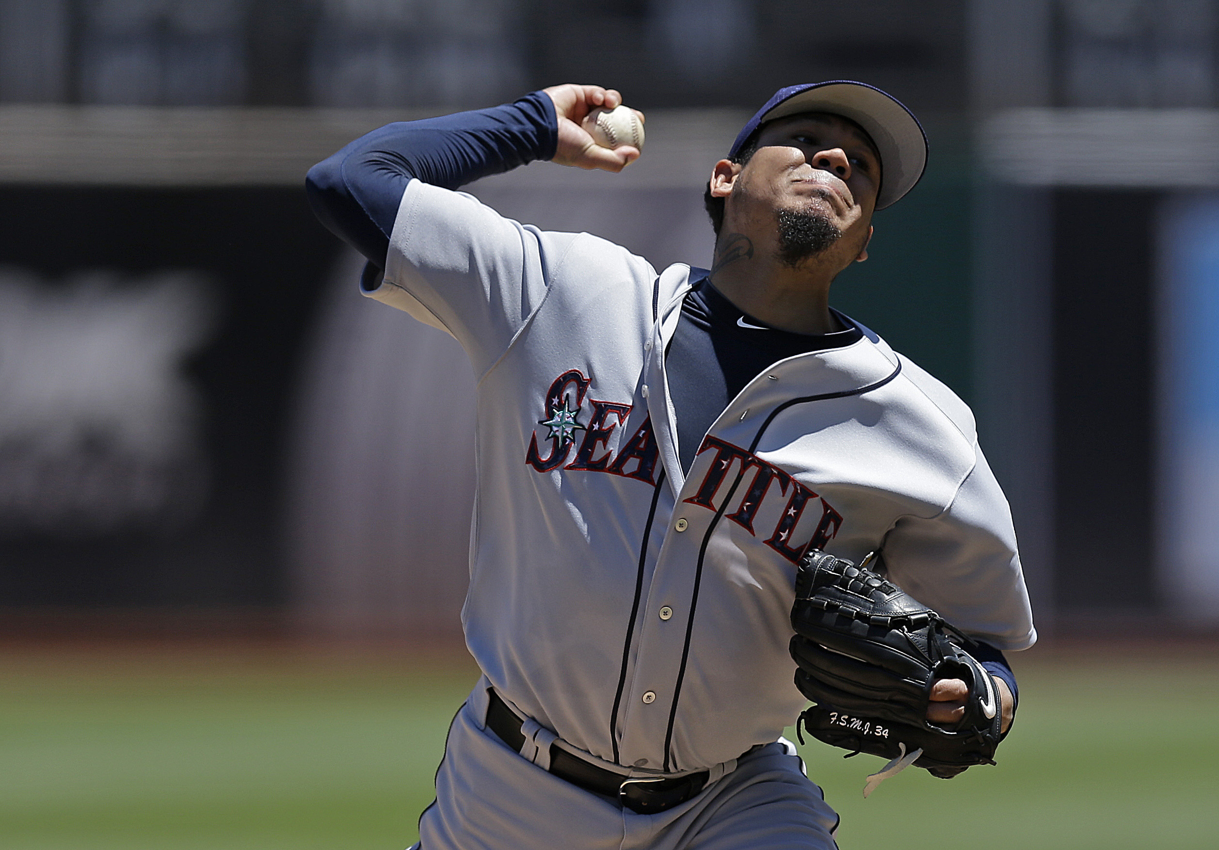 Seattle Mariners pitcher Felix Hernandez works against the Oakland Athletics in the first inning of a baseball game Saturday, July 4, 2015, in Oakland, Calif. (AP Photo/Ben Margot)