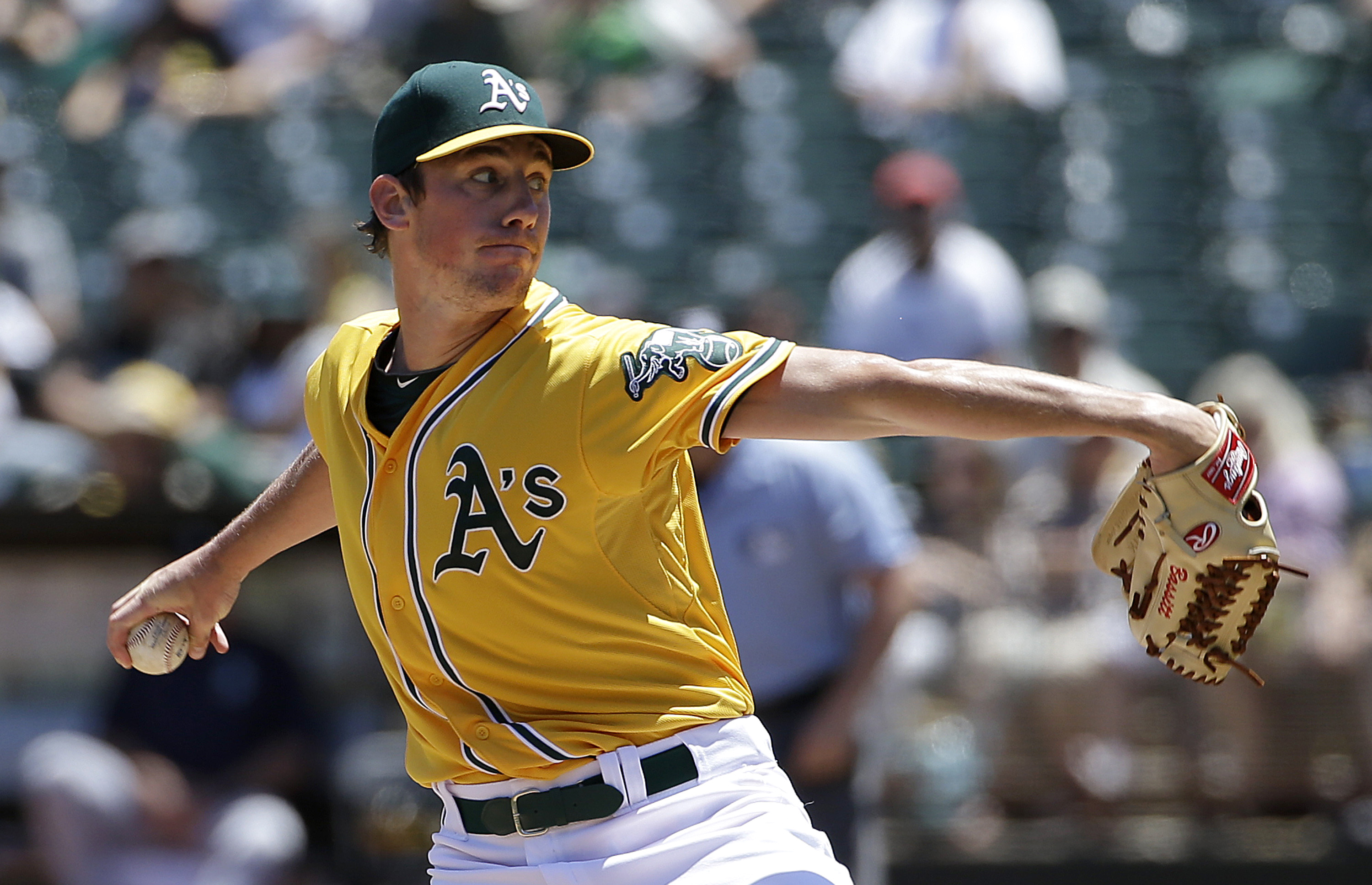Oakland Athletics pitcher Chris Bassitt throws against the Seattle Mariners during the first inning of a baseball game in Oakland, Calif., Sunday, July 5, 2015. (AP Photo/Jeff Chiu)