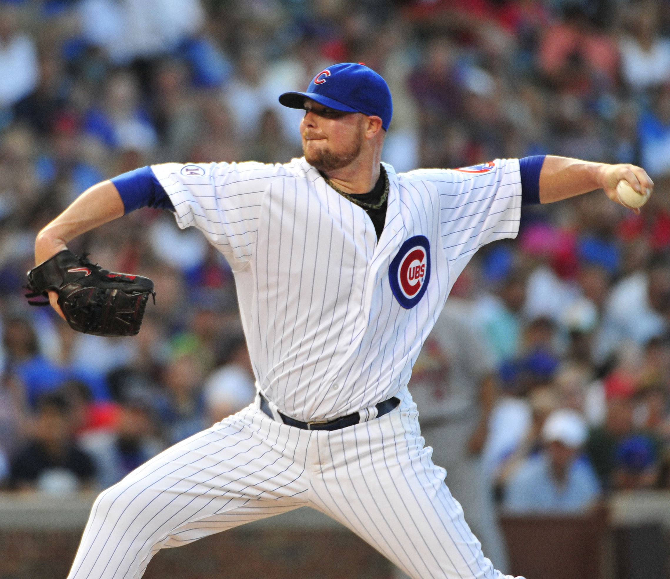 Chicago Cubs starting pitcher Jon Lester throws against the St. Louis Cardinals during the first inning of a baseball game, Monday, July  6, 2015, in Chicago. (AP Photo/David Banks)