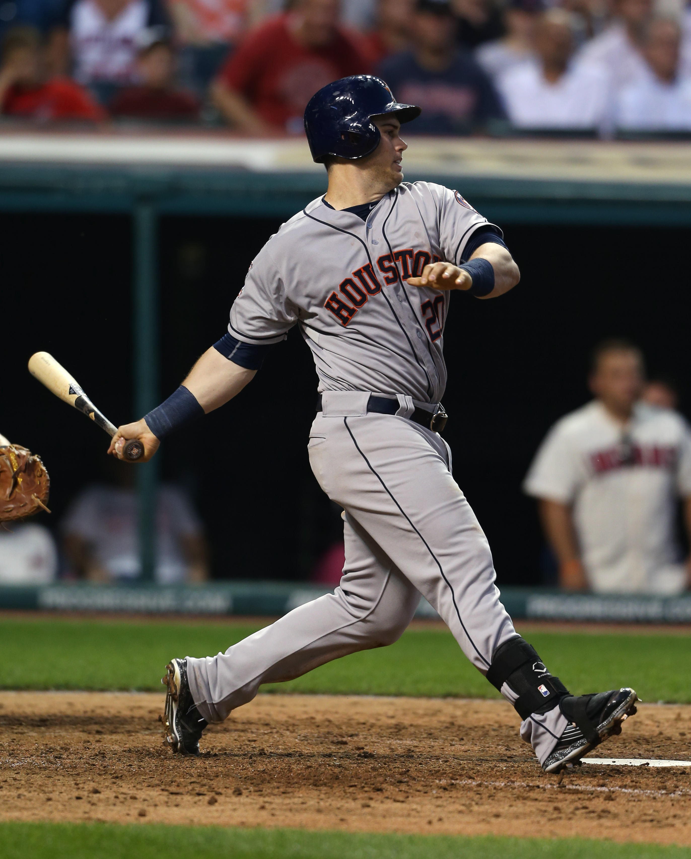 Houston Astros left fielder Preston Tucker  hits an RBI single off Cleveland Indians relief pitcher Austin Adams during the sixth inning of a baseball game, Monday, July 6, 2015, in Cleveland. (AP Photo/Ron Schwane)