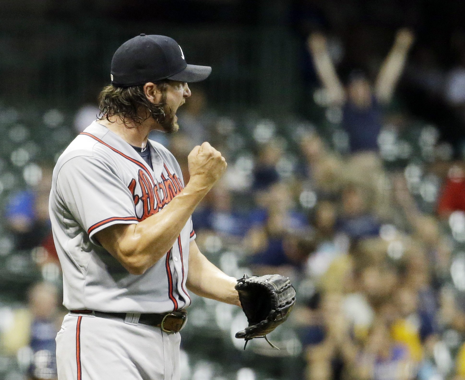 Atlanta Braves relief pitcher Jason Grilli reacts after getting Milwaukee Brewers' Jonathan Lucroy to ground out and end the ninth inning of a baseball game Monday, July 6, 2015, in Milwaukee. The Braves won 5-3. (AP Photo/Morry Gash)