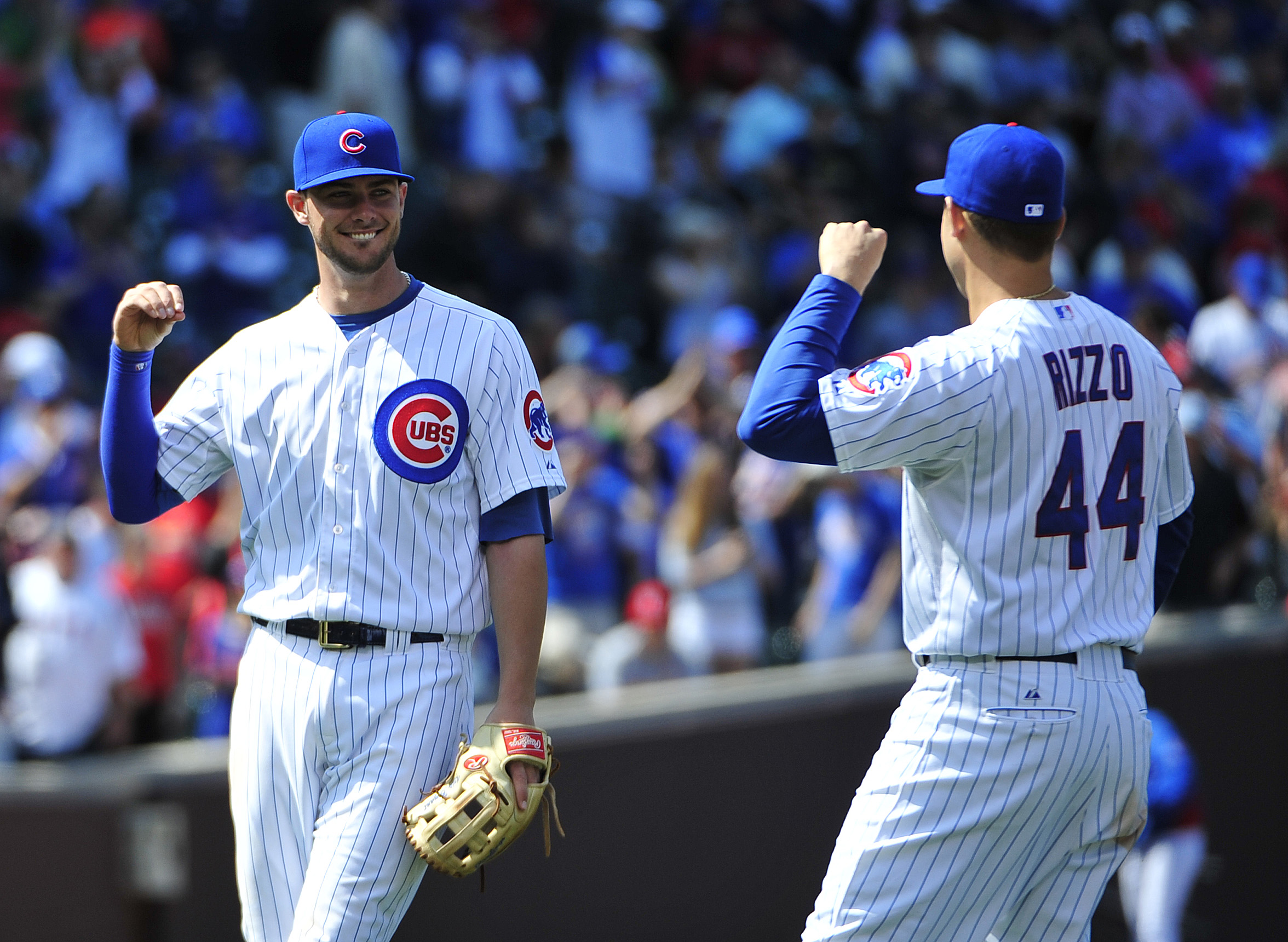 Chicago Cubs third baseman Kris Bryant, left, and first baseman Anthony Rizzo (44) celebrate the Cubs' 7-4 win against the St. Louis Cardinals in the first baseball game of a doubleheader, Tuesday, July  7, 2015, in Chicago. (AP Photo/David Banks)
