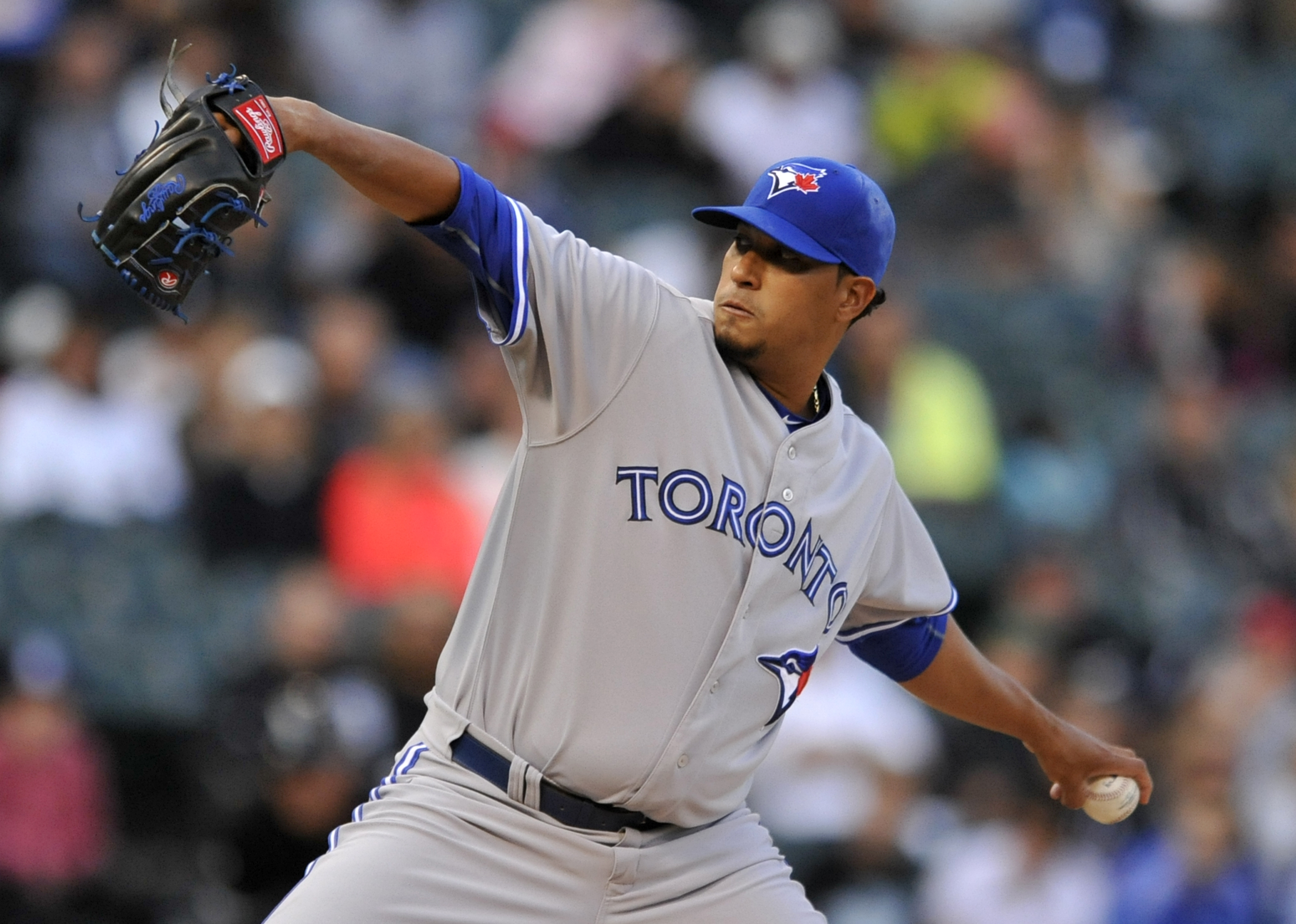 Toronto Blue Jays starter Felix Doubront (57), delivers a pitch during the first inning of a baseball game against the Chicago White Sox Tuesday, July 7, 2015, in Chicago. (AP Photo/Paul Beaty)