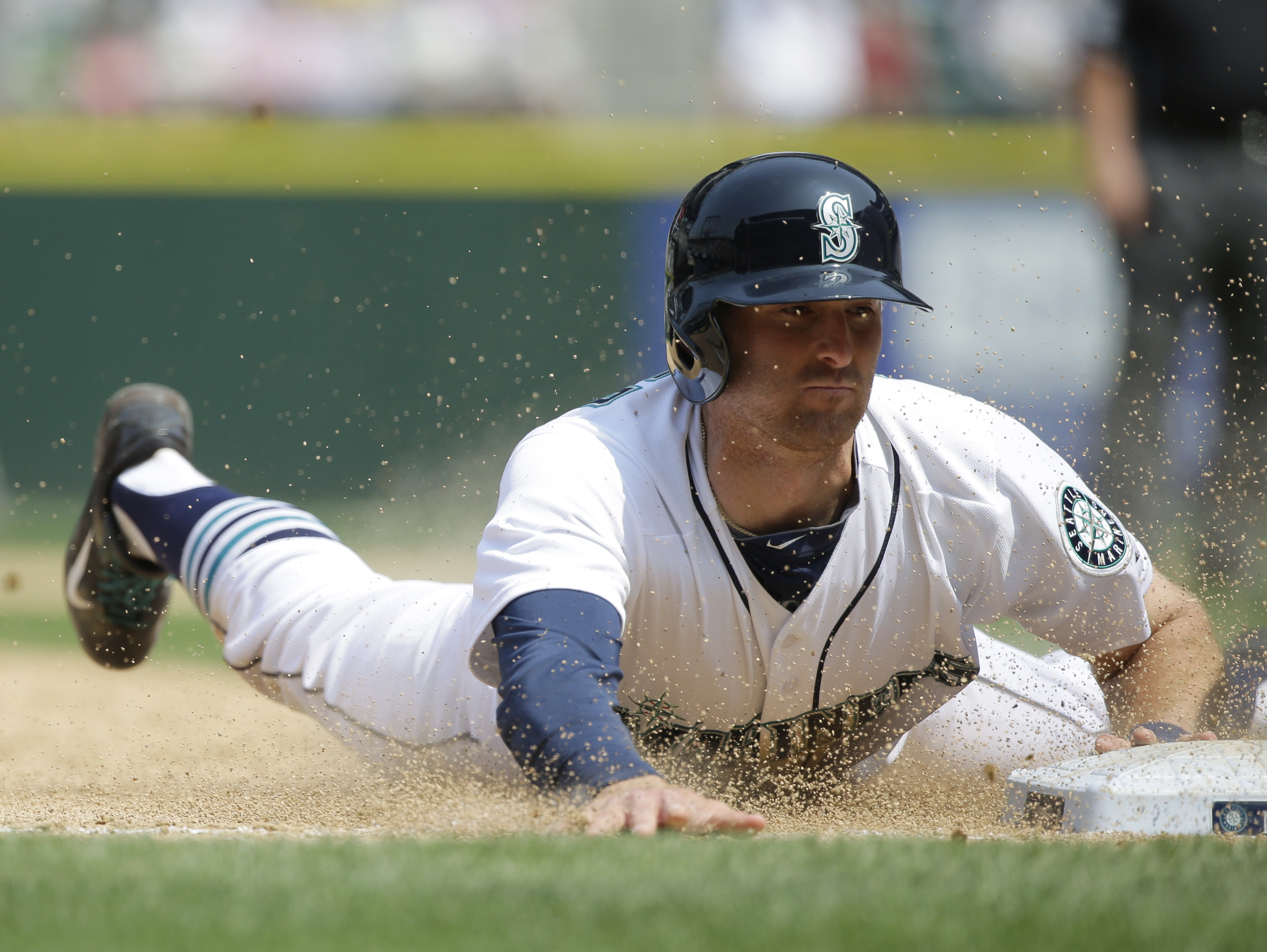 Seattle Mariners' Brad Miller steals third base during the sixth inning of a baseball game against the Detroit Tigers, Wednesday, July 8, 2015, in Seattle. (AP Photo/Ted S. Warren)