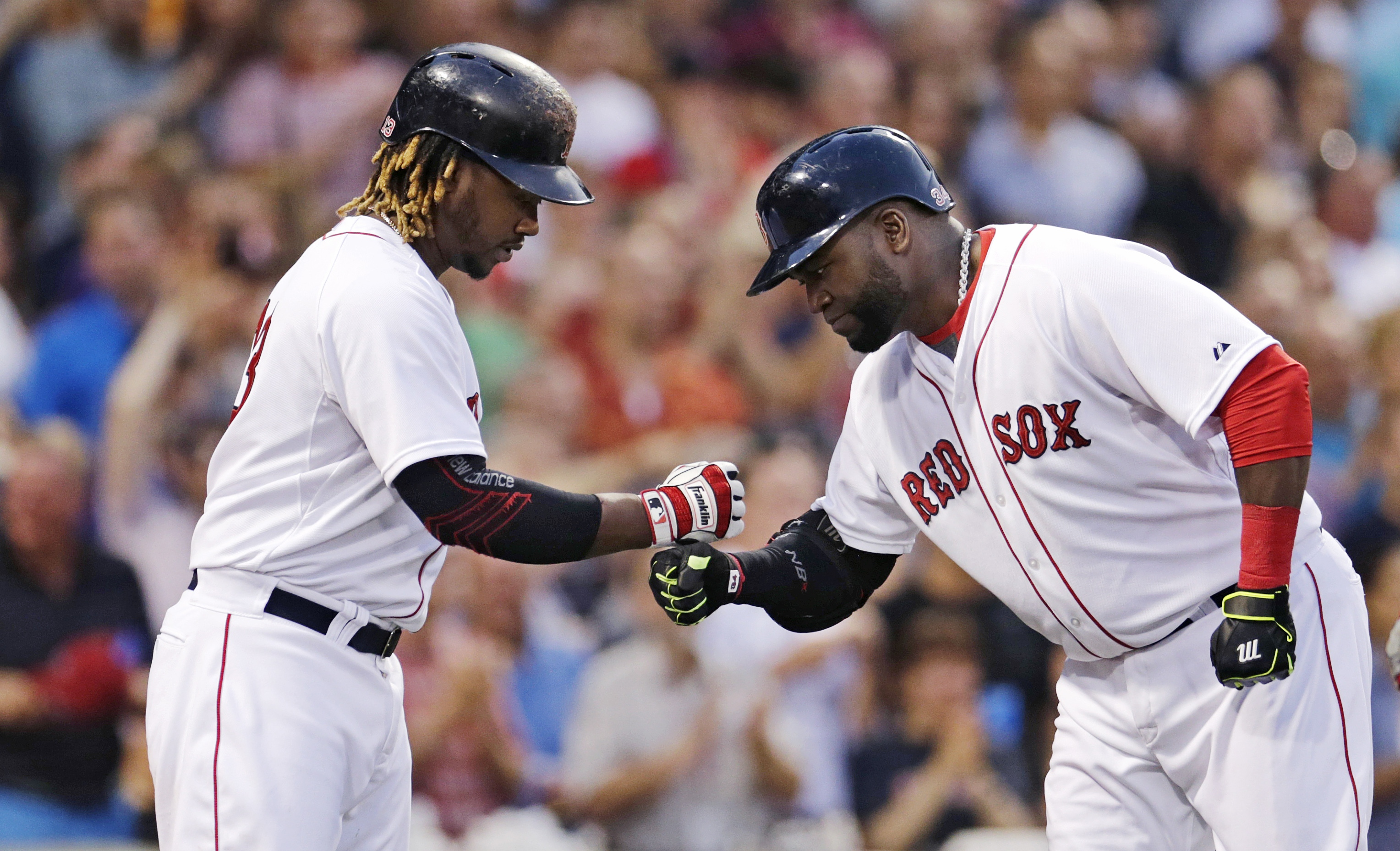 Boston Red Sox's David Ortiz is congratulated by designated hitter Hanley Ramirez after his two-run home run during the third inning a baseball game against the Miami Marlins at Fenway Park, Wednesday July 8, 2015, in Boston. (AP Photo/Charles Krupa)