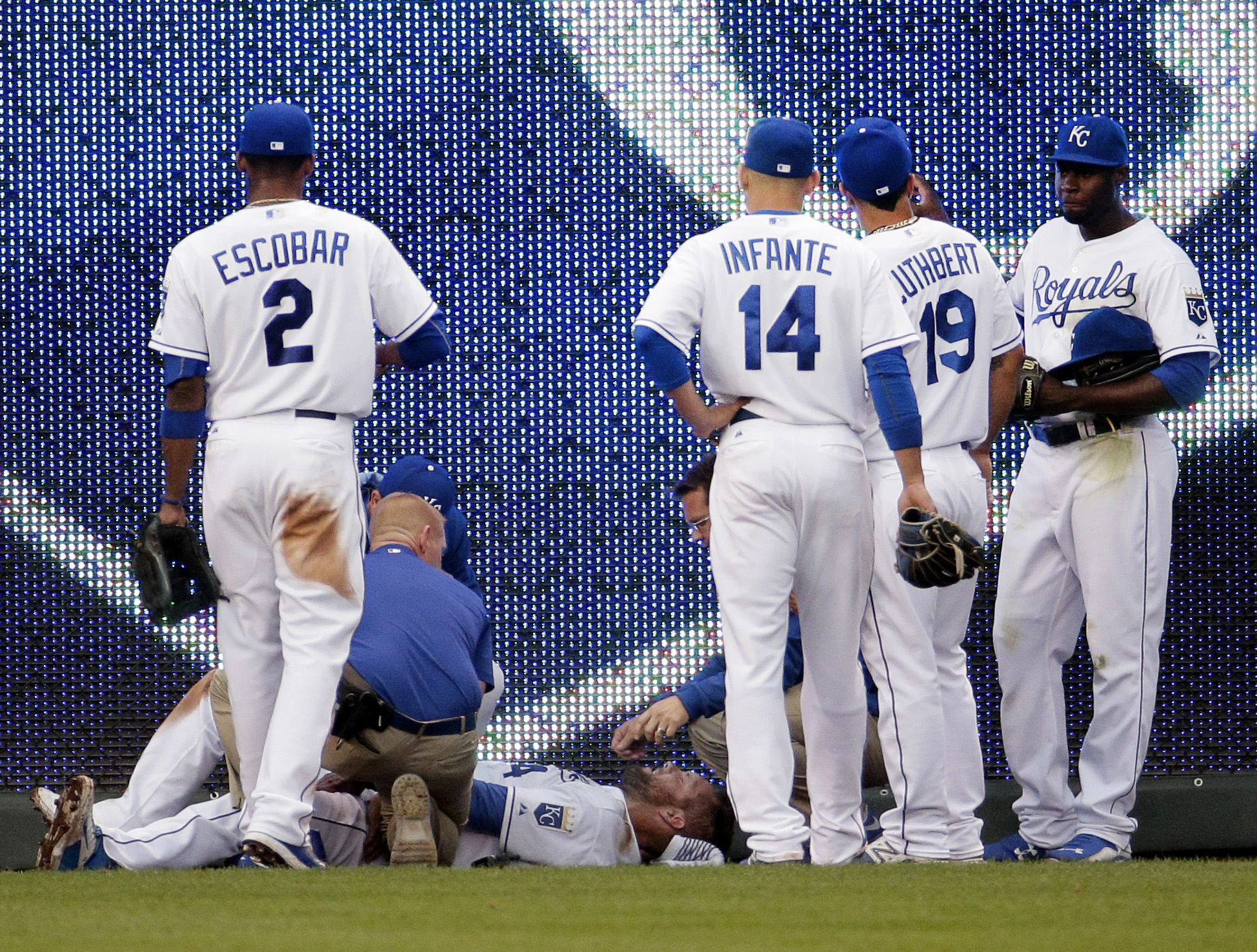 Kansas City Royals left fielder Alex Gordon receives attention after sustaining an injury while attempting to field an inside-the-park home run by Tampa Bay Rays' Logan Forsythe during the fourth inning of a baseball game Wednesday, July 8, 2015, in Kansa