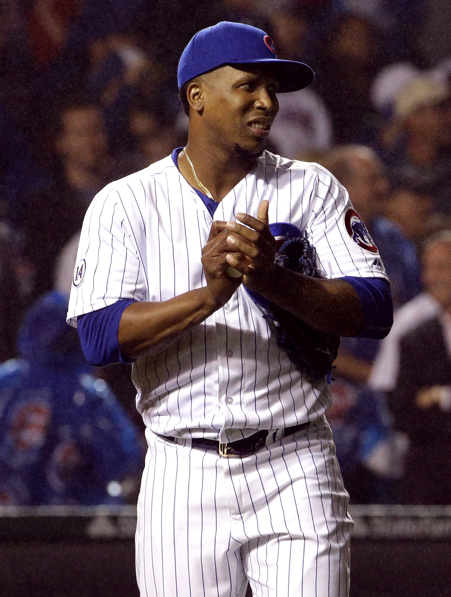 Chicago Cubs relief pitcher Pedro Strop reacts after St. Louis Cardinals' Jhonny Peralta hit a two-run home run during the ninth inning of a baseball game Wednesday, July 8, 2015, in Chicago. (AP Photo/Nam Y. Huh)