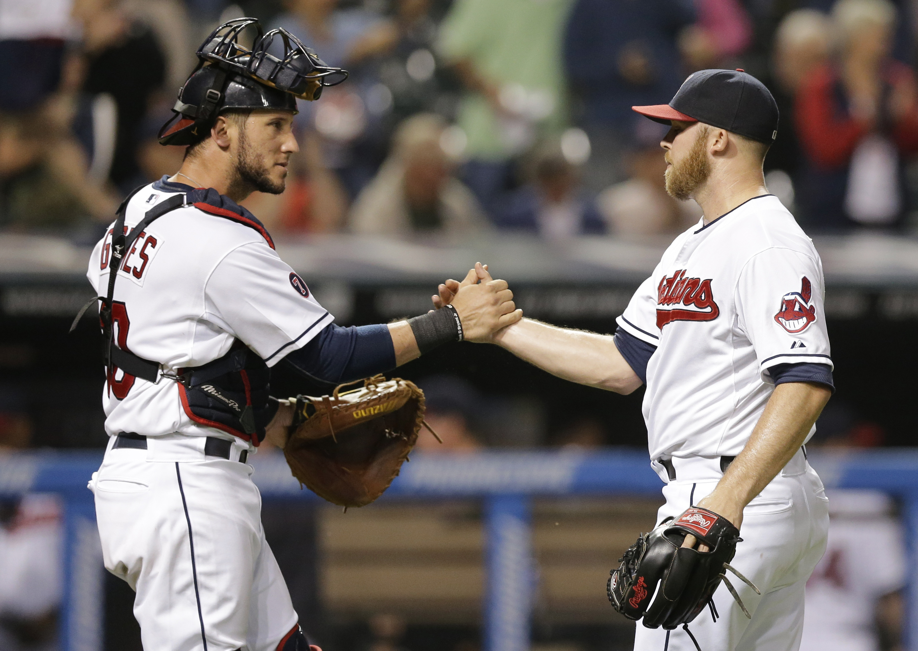 Cleveland Indians relief pitcher Cody Allen, right, is congratulated by catcher Yan Gomes after the Indians defeated the Houston Astros 3-1 in a baseball game, Thursday, July 9, 2015, in Cleveland. (AP Photo/Tony Dejak)