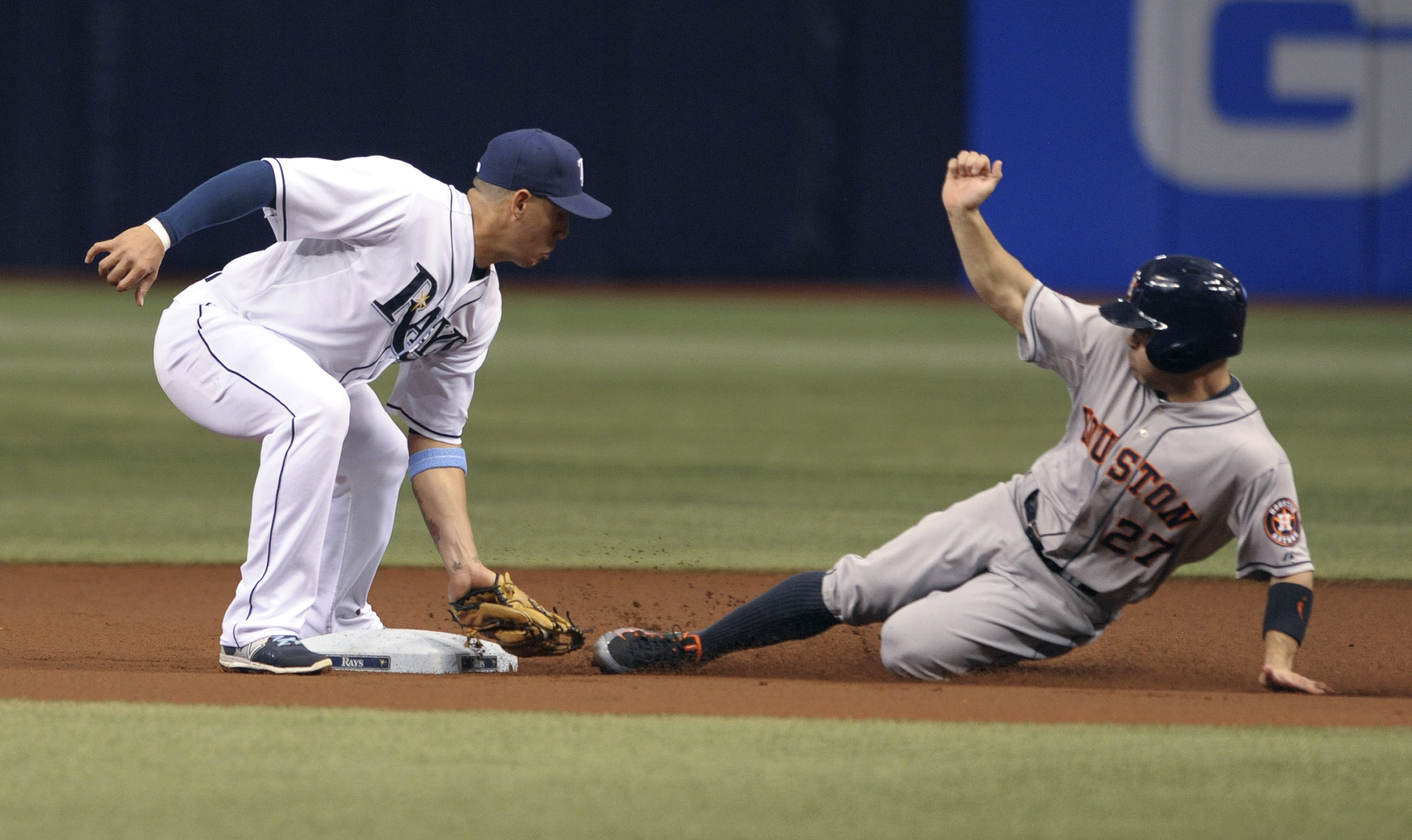 Tampa Bay Rays shortstop Asdrubal Cabrera, left, applies the tag on a stolen base attempt by Houston Astros' Jose Altuve during the first inning of a baseball game Friday, July 10, 2015, in St. Petersburg, Fla. (AP Photo/Steve Nesius)