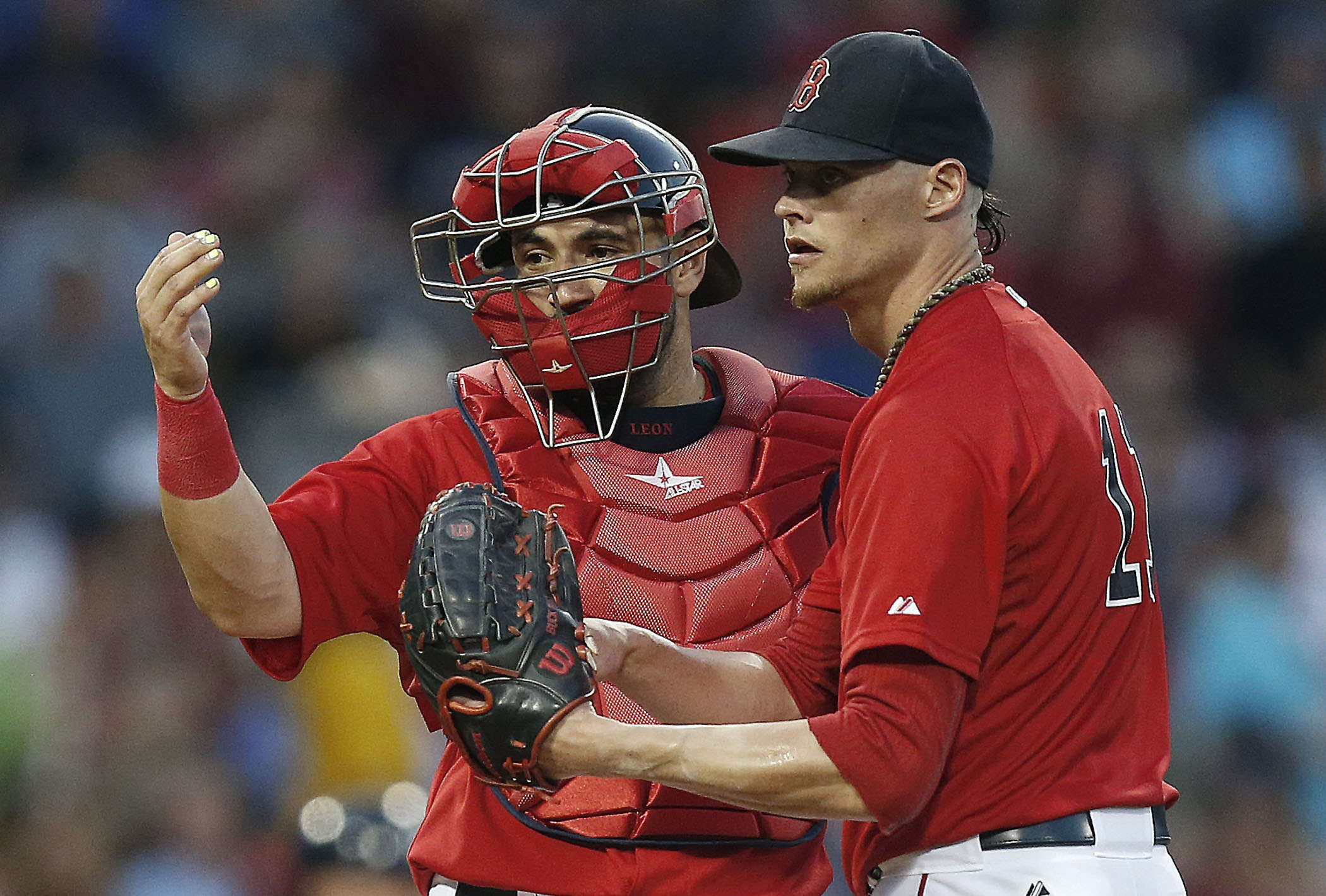 Boston Red Sox's Sandy Leon, left, signals to the dugout beside Clay Buchholz during the fourth inning of a baseball game against the New York Yankees in Boston, Friday, July 10, 2015. Manager John Farrell came to the mound and Buchholz left the game. (AP