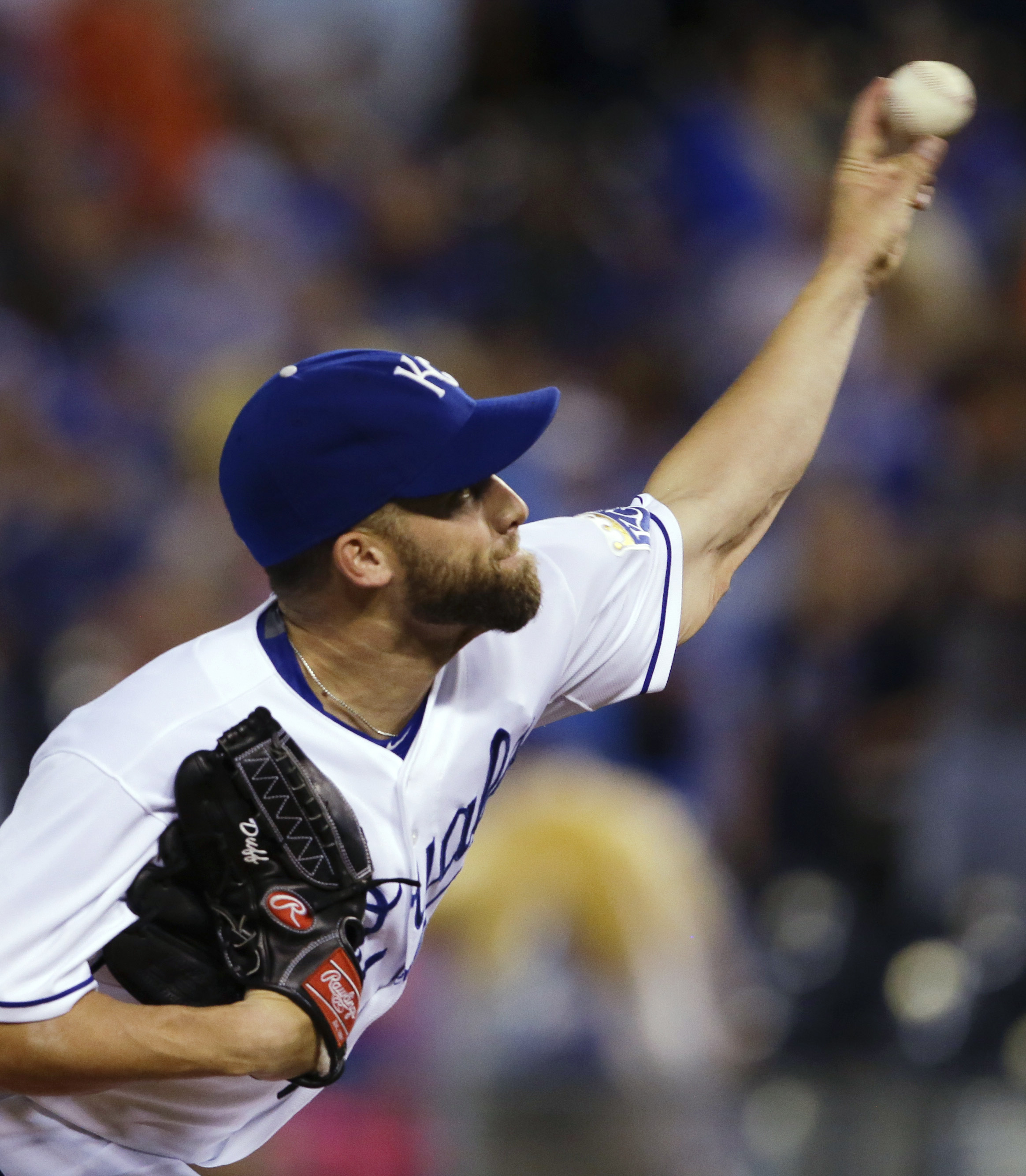 Kansas City Royals starting pitcher Danny Duffy delivers to a Toronto Blue Jays batter during the first inning of a baseball game at Kauffman Stadium in Kansas City, Mo., Friday, July 10, 2015. (AP Photo/Orlin Wagner)
