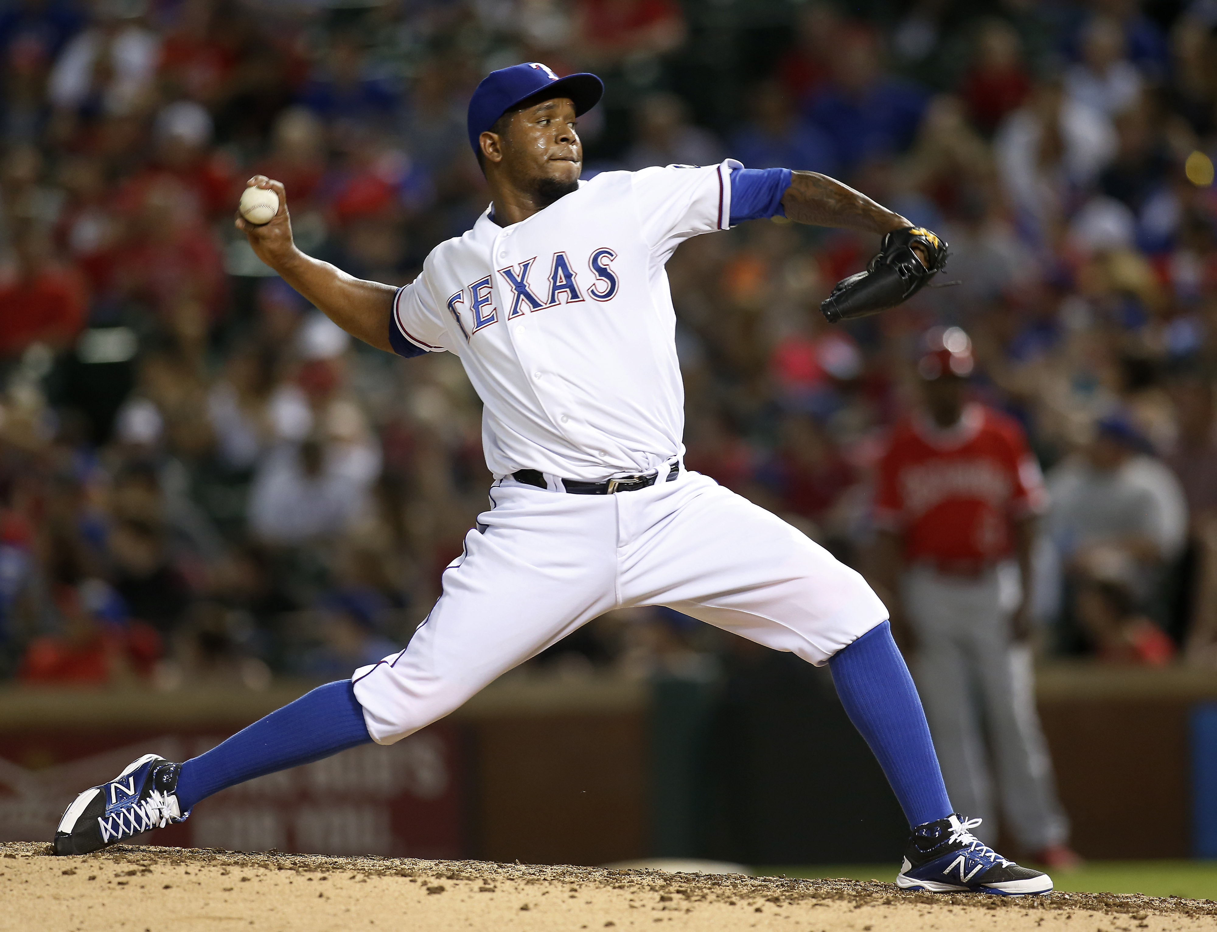 Texas Rangers relief pitcher Neftali Feliz throws against the Los Angeles Angels during the seventh inning of a baseball game in Arlington, Texas, on Friday, July 3, 2015. (AP Photo/Brad Loper)