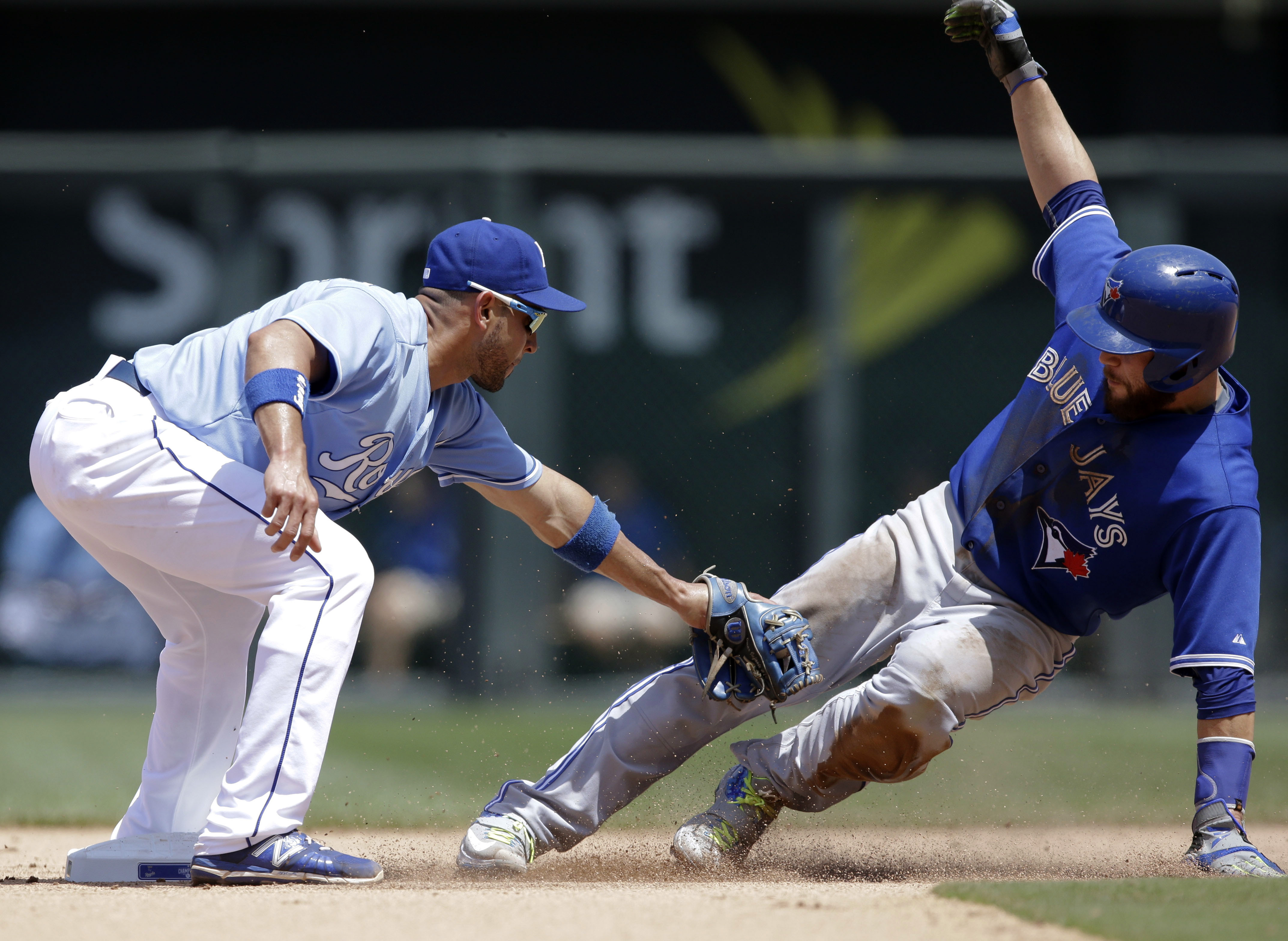 Kansas City Royals second baseman Omar Infante, left, tags out Toronto Blue Jays' Russell Martin, right, during the sixth inning of a baseball game at Kauffman Stadium in Kansas City, Mo., Saturday, July 11, 2015. Martin was caught stealing on the play. (