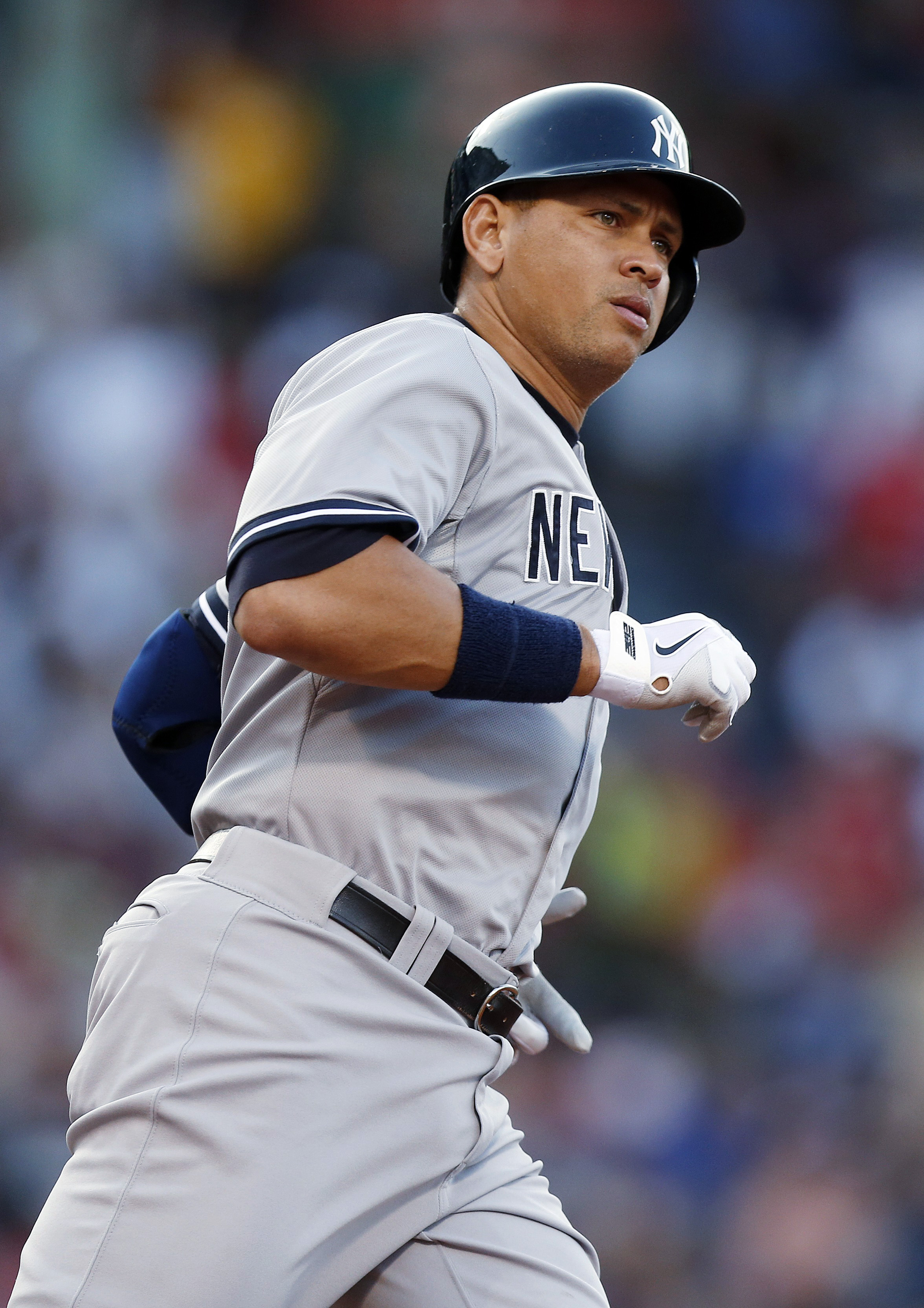 New York Yankees' Alex Rodriguez rounds first base on his solo home run during the first inning of a baseball game against the Boston Red Sox in Boston, Saturday, July 11, 2015. (AP Photo/Michael Dwyer)