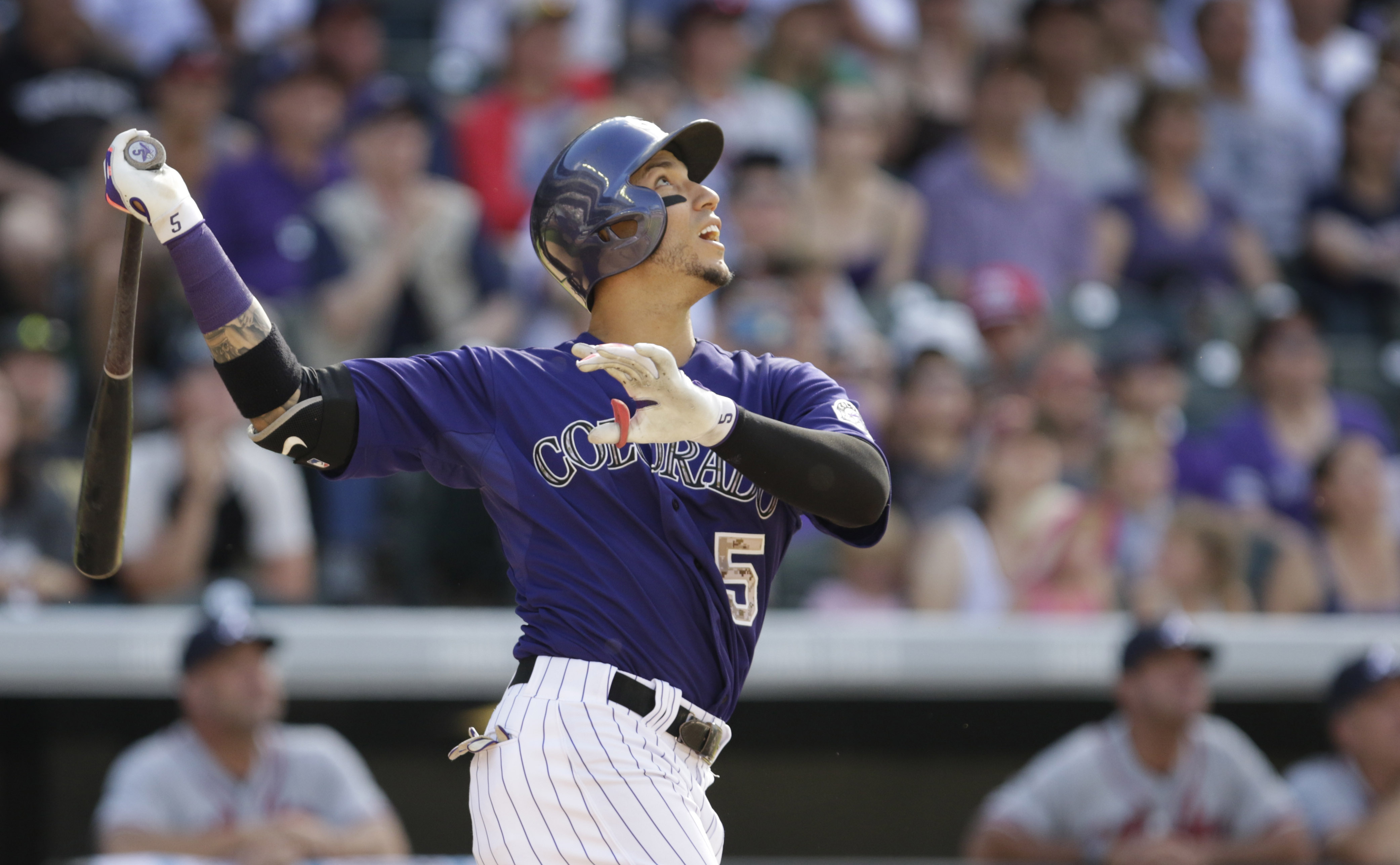 Colorado Rockies' Carlos Gonzalez watches his game-winning RBI-single against the Atlanta Braves for a 3-2 victory in the ninth inning of a baseball game in Denver, Saturday, July 11, 2015. (AP Photo/Joe Mahoney)