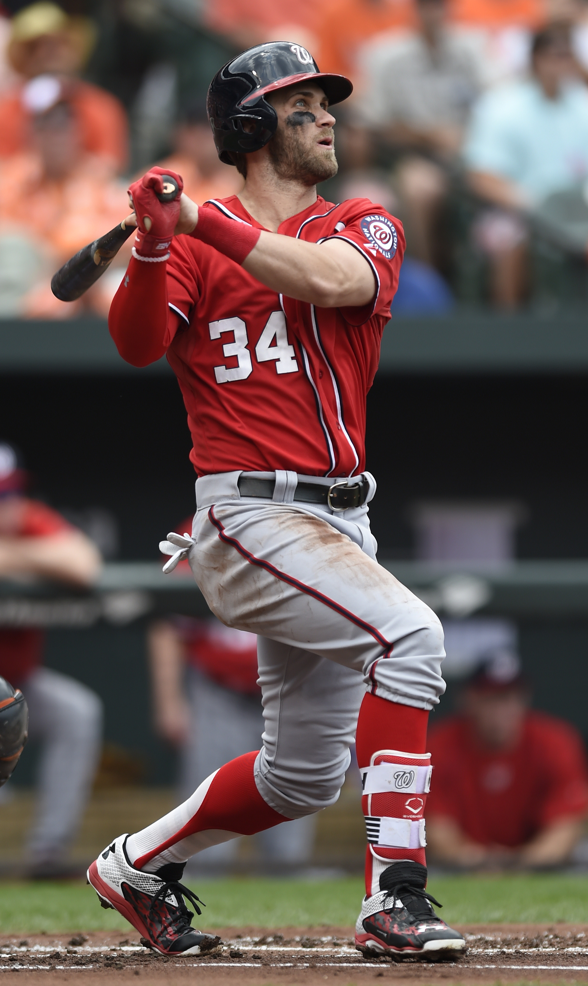 Washington Nationals' Bryce Harper follows through on a double against the Baltimore Orioles  in the first inning of a baseball game Sunday, July 12, 2015, in Baltimore. (AP Photo/Gail Burton)