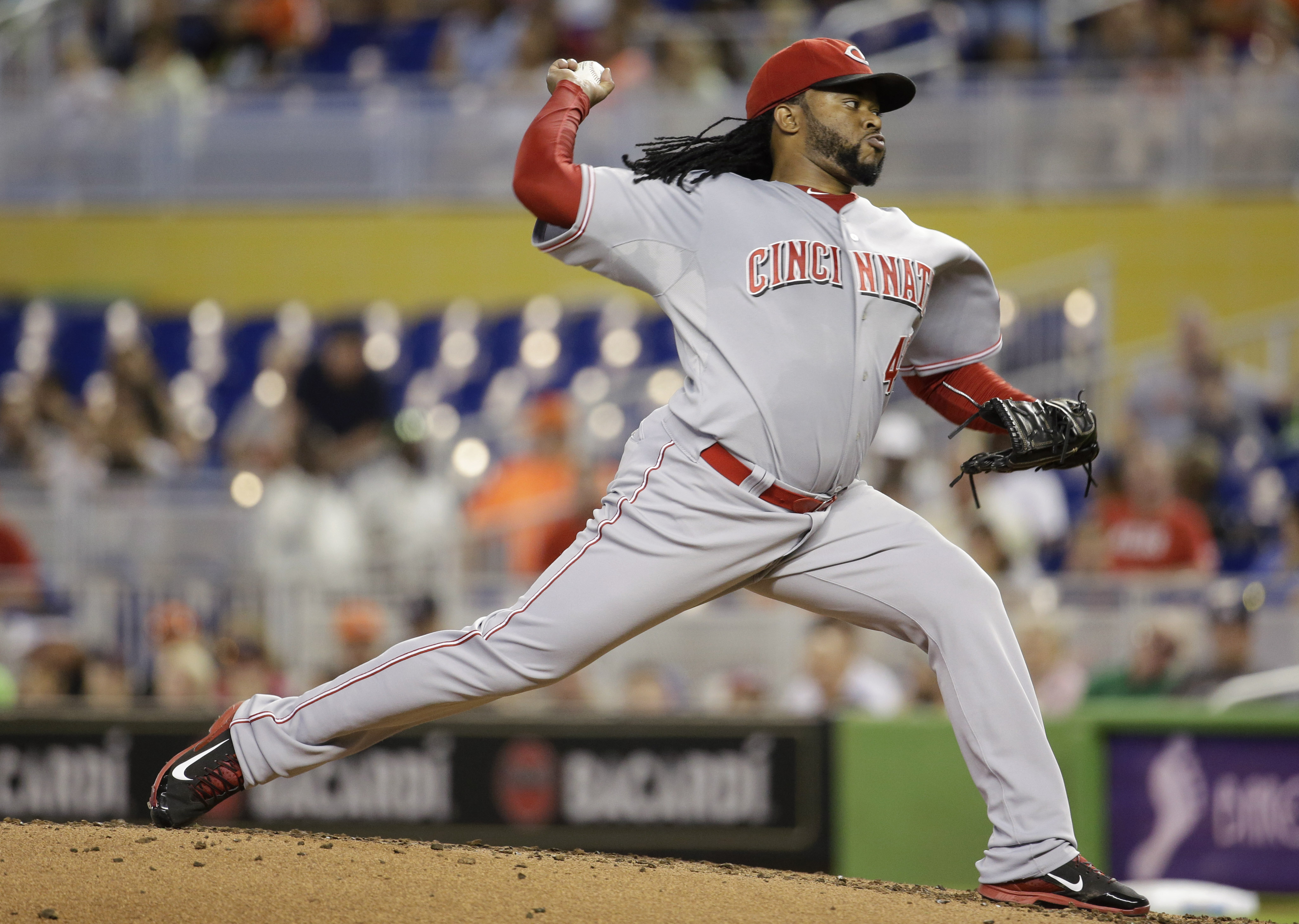 Cincinnati Reds starting pitcher Johnny Cueto throws in the first inning of a baseball game against the Miami Marlins, Sunday, July 12, 2015, in Miami. (AP Photo/Lynne Sladky)