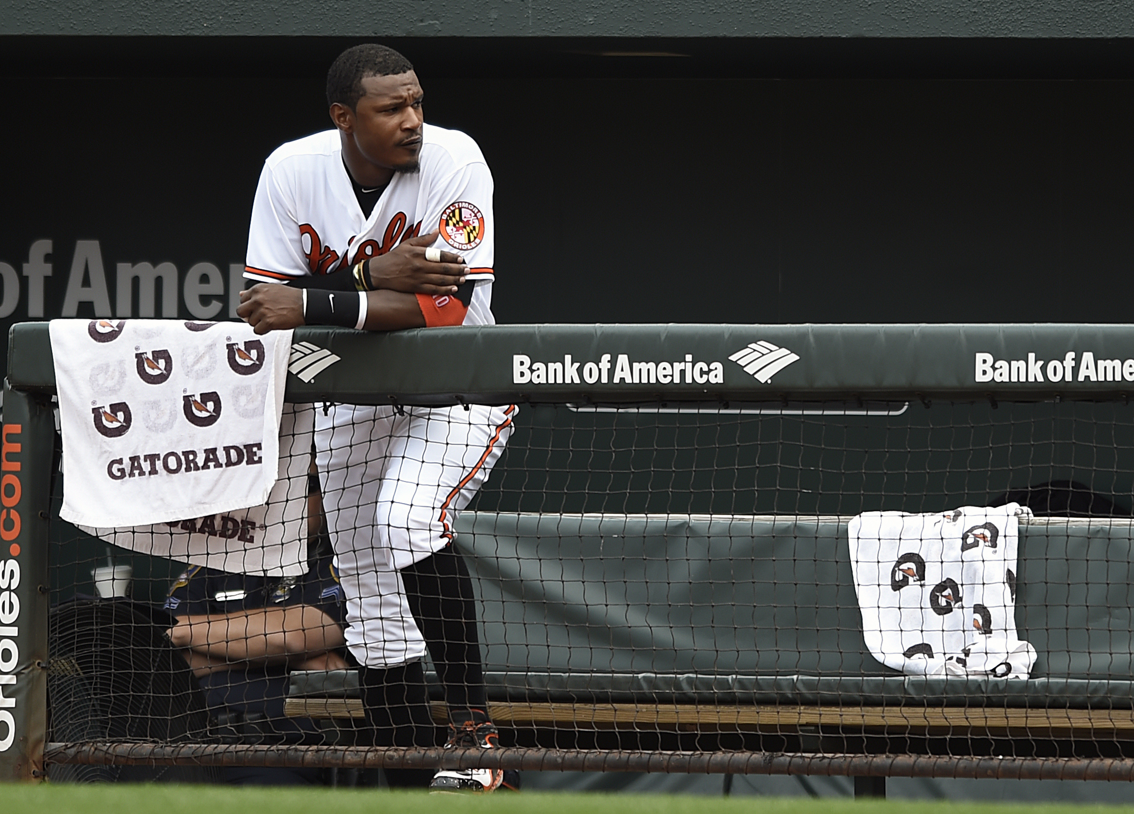 Baltimore Orioles' Adam Jones watches from the dugout in the eighth inning of a baseball game against the Washington Nationals, Sunday, July 12, 2015, in Baltimore. The Nationals won 3-2. (AP Photo/Gail Burton)