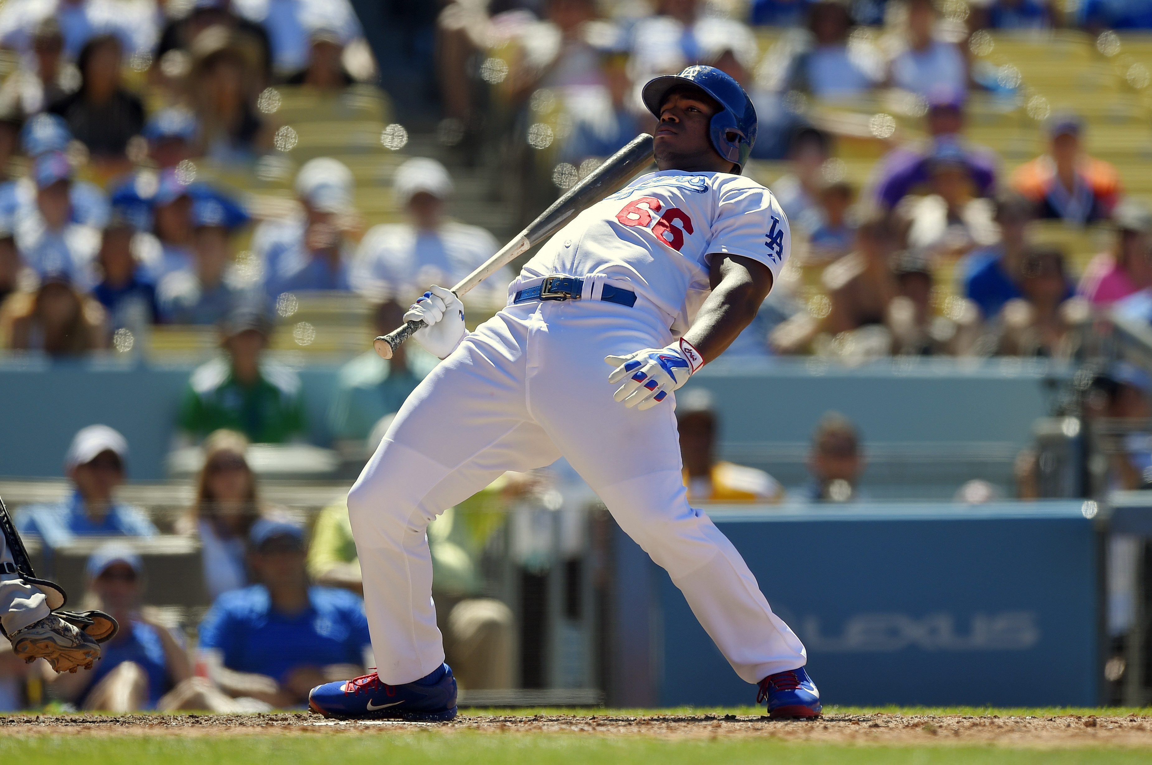 Los Angeles Dodgers' Yasiel Puig leans out of the way of a close pitch during the eighth inning of a baseball game against the Milwaukee Brewers, Sunday, July 12, 2015, in Los Angeles. (AP Photo/Mark J. Terrill)