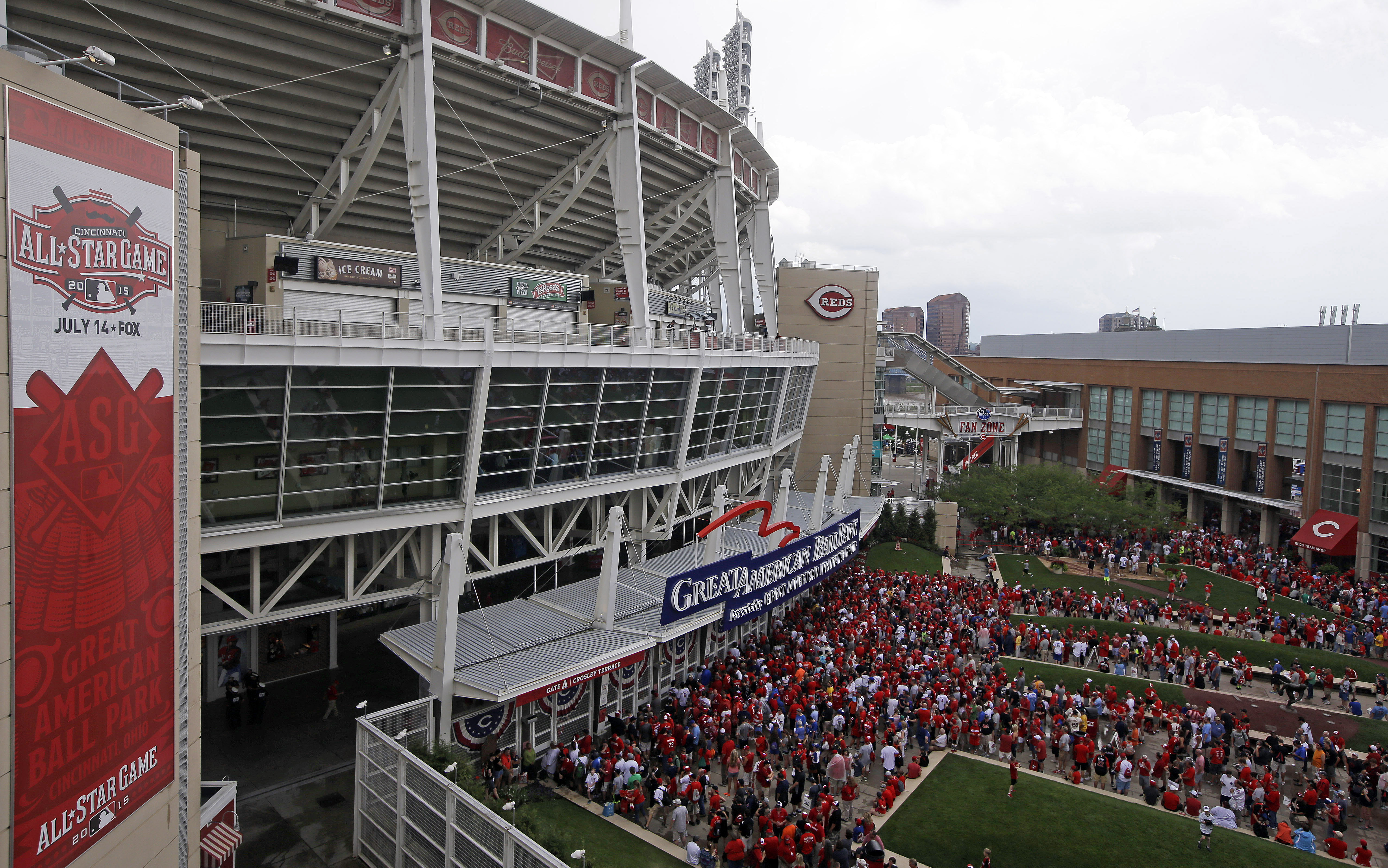 Fans wait to enter Great American Ball Park for the MLB All-Star baseball game, Tuesday, July 14, 2015, in Cincinnati. (AP Photo/John Minchillo)