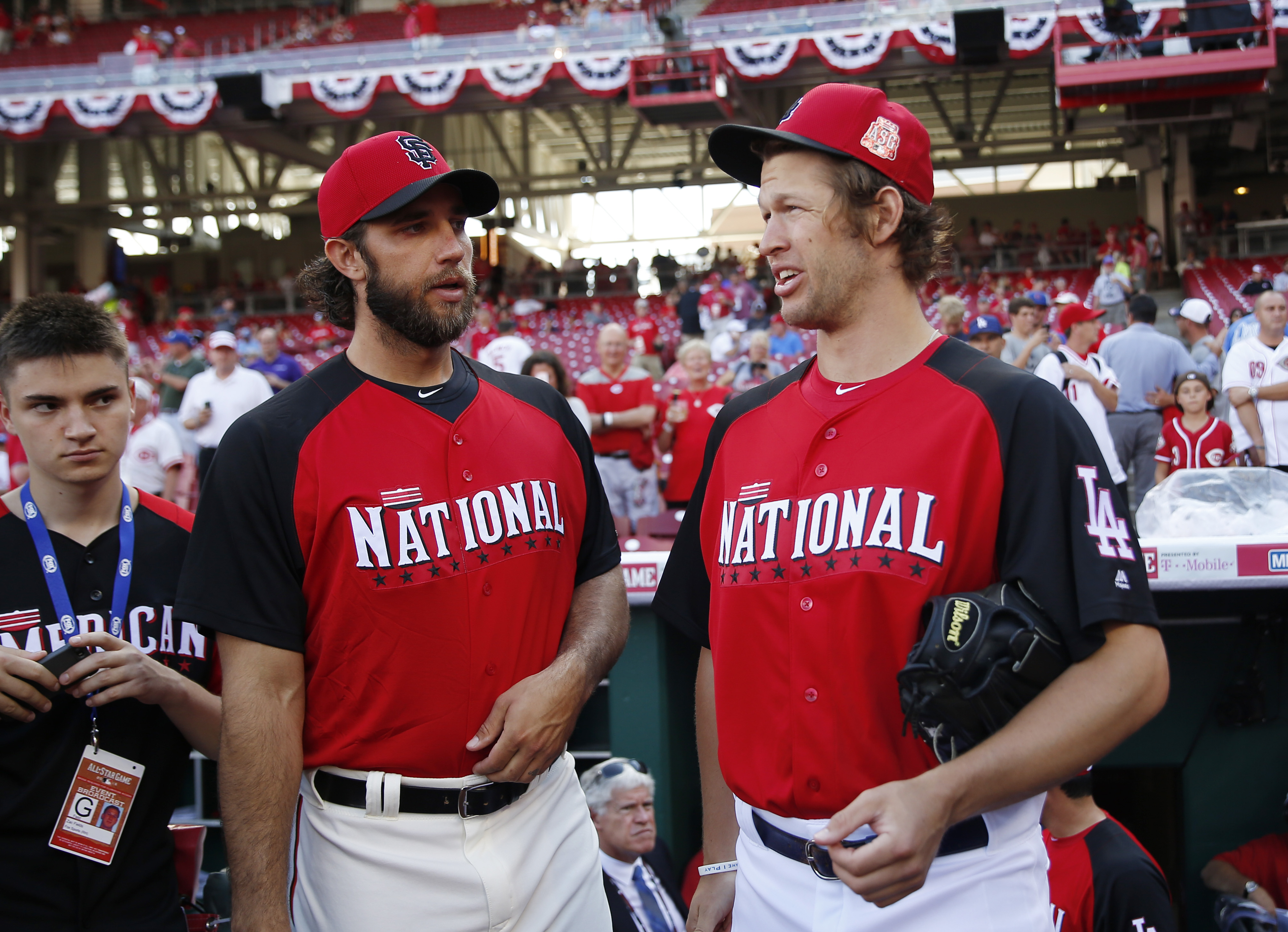 National League's Madison Bumgarner, of the San Francisco Giants, talks with Clayton Kershaw, of the Los Angeles Dodgers, before the MLB All-Star baseball game, Tuesday, July 14, 2015, in Cincinnati. (AP Photo/Jeff Roberson)