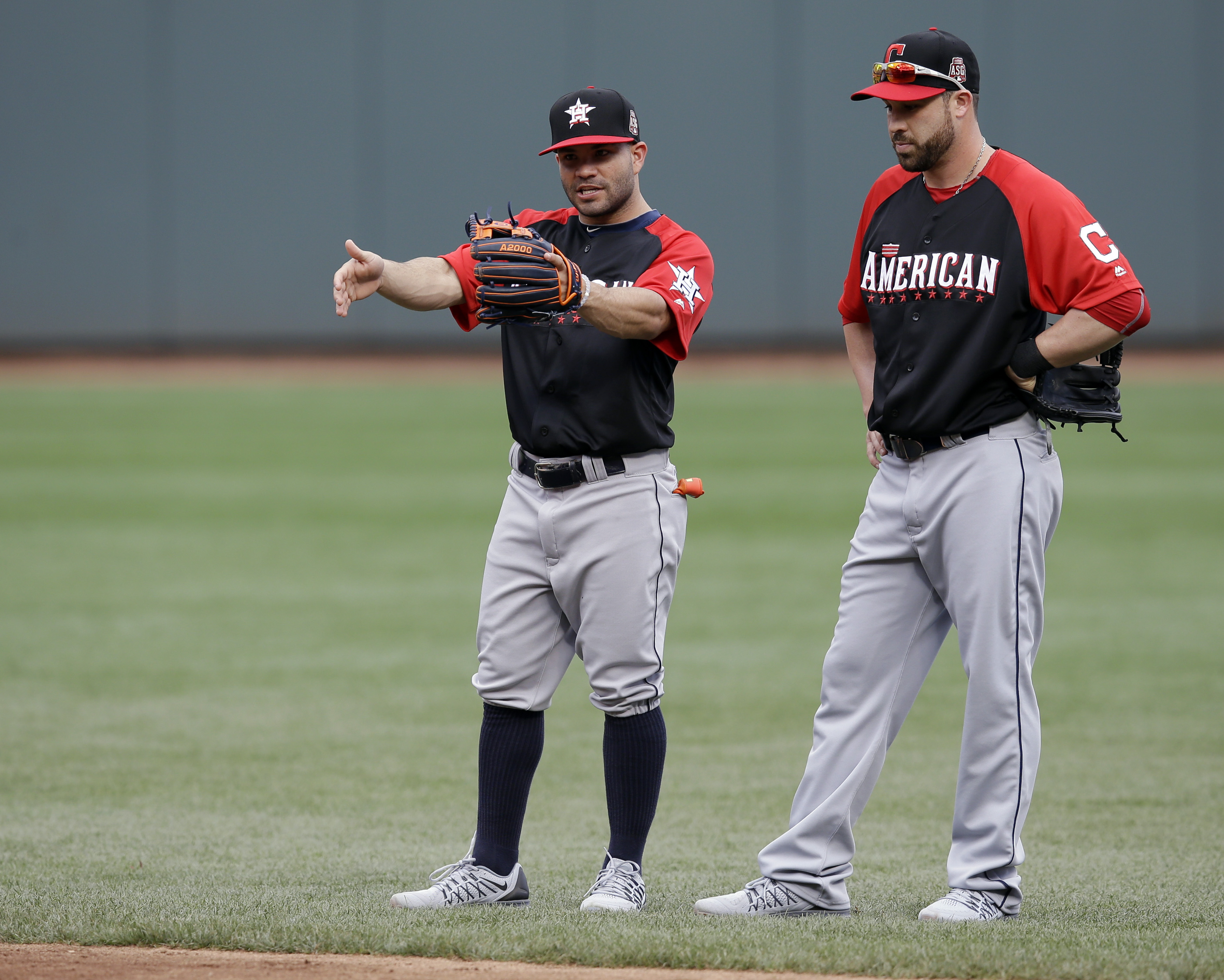 American League's Jose Altuve, left, of the Houston Astros, talks with Jason Kipnis, of the Cleveland Indians, during fielding practice before the MLB All-Star baseball game, Tuesday, July 14, 2015, in Cincinnati. (AP Photo/John Minchillo)