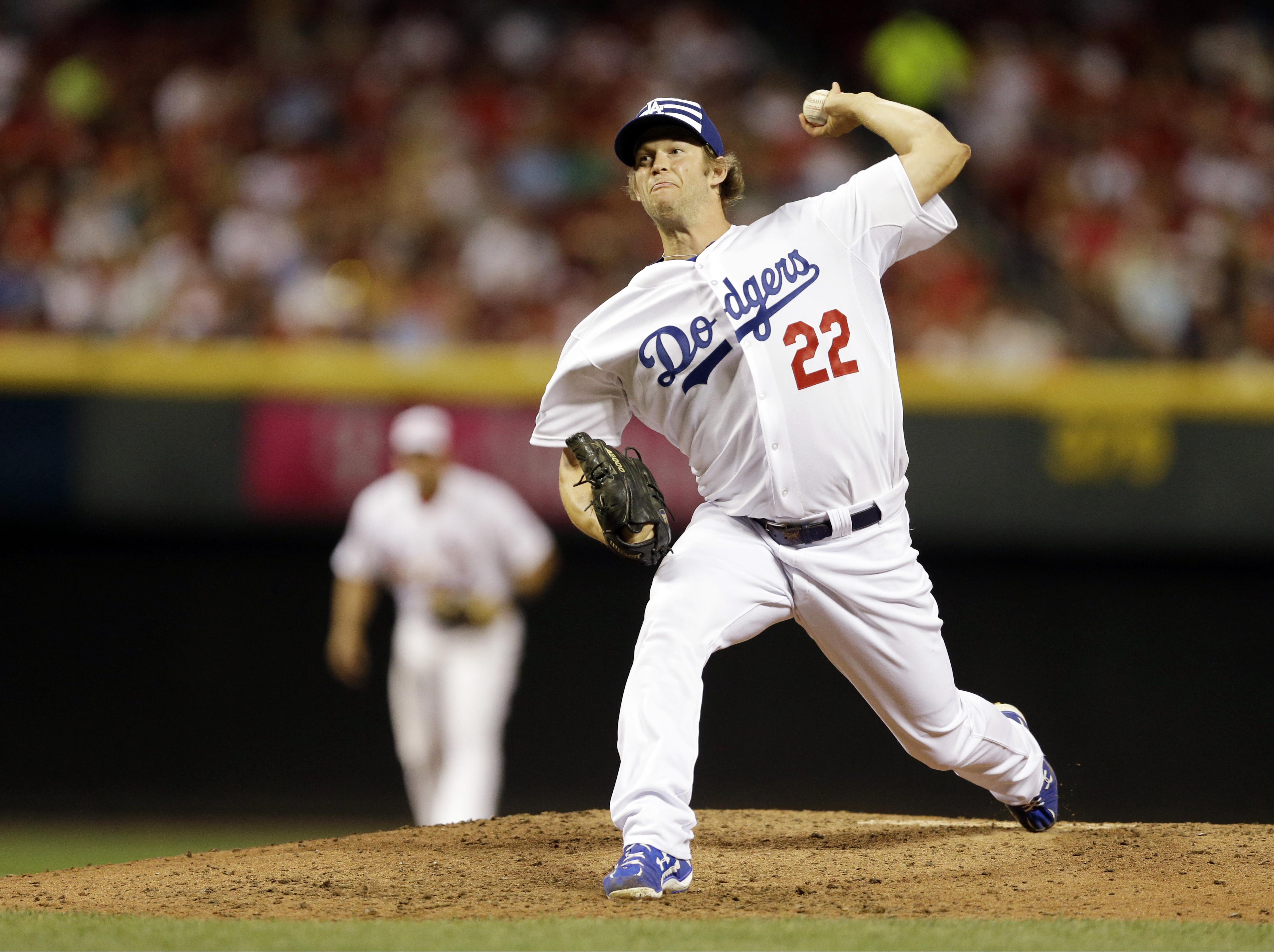 National League's Clayton Kershaw, of the Los Angeles Dodgers, throws during the fifth  inning of the MLB All-Star baseball game, Tuesday, July 14, 2015, in Cincinnati. (AP Photo/Jeff Roberson)