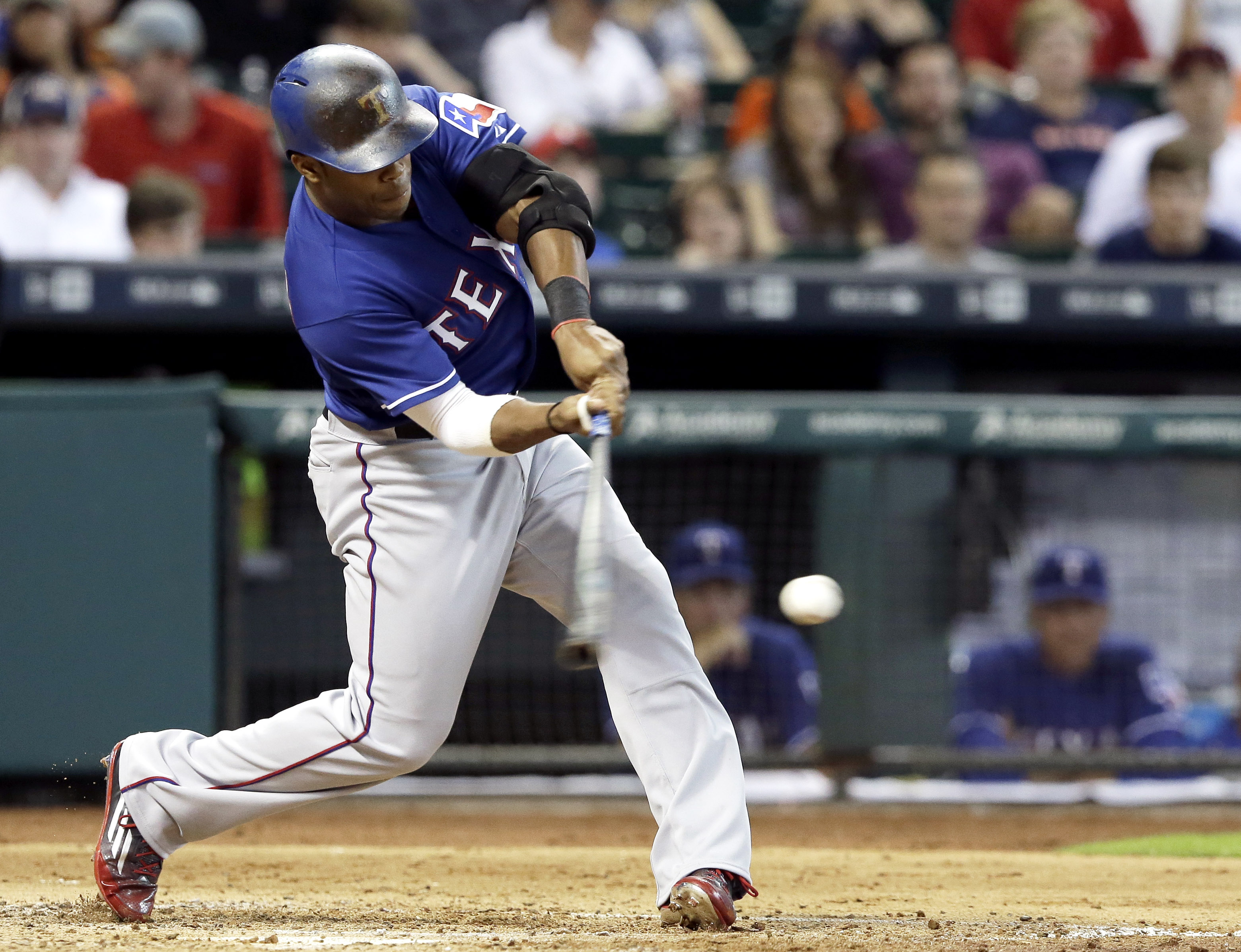 Texas Rangers' Delino DeShields hits a single to left field against the Houston Astros in the third inning of a baseball game Friday, July 17, 2015, in Houston. (AP Photo/Pat Sullivan)