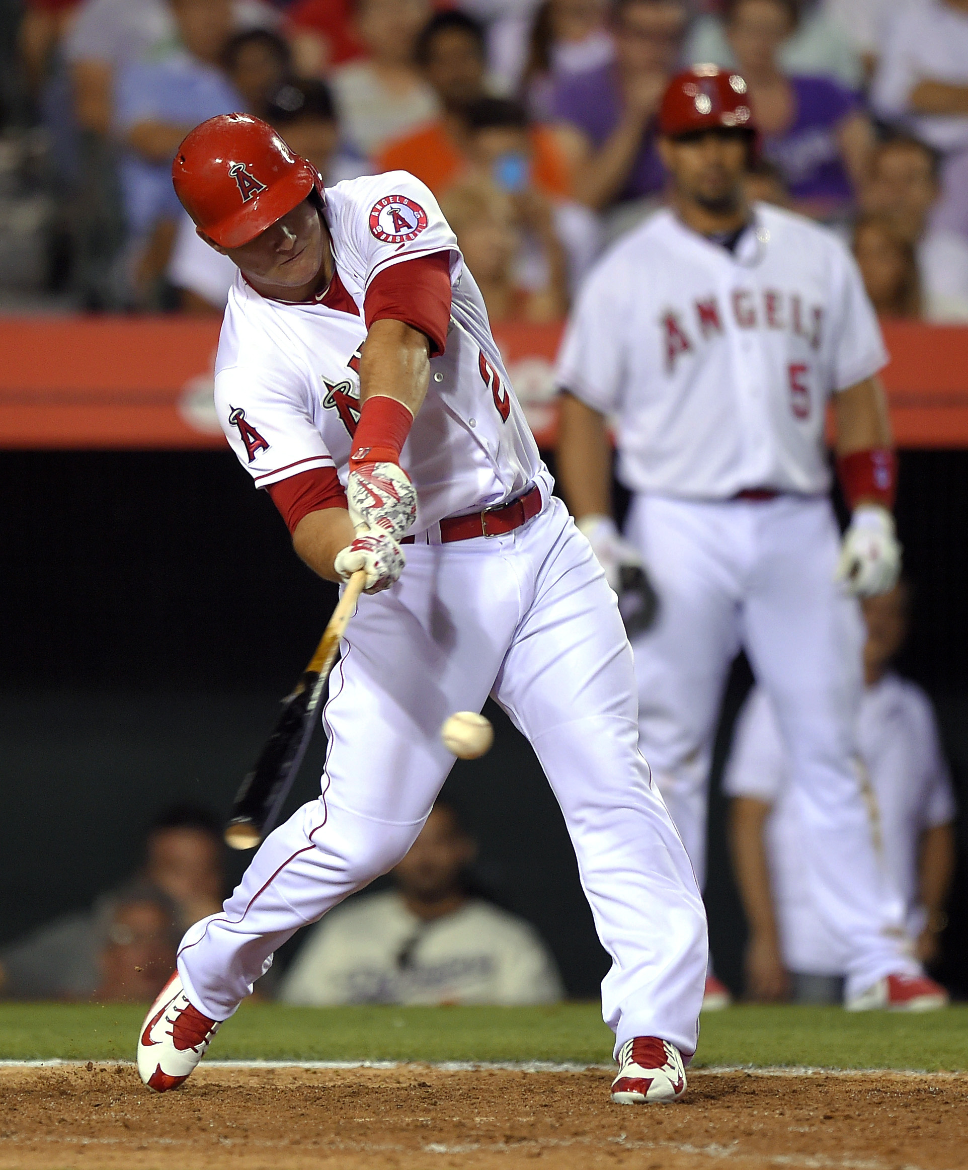 Los Angeles Angels' Mike Trout hits a solo home run during the ninth inning of a baseball game against the Boston Red Sox, Friday, July 17, 2015, in Anaheim, Calif. The Angels won 1-0. (AP Photo/Mark J. Terrill)