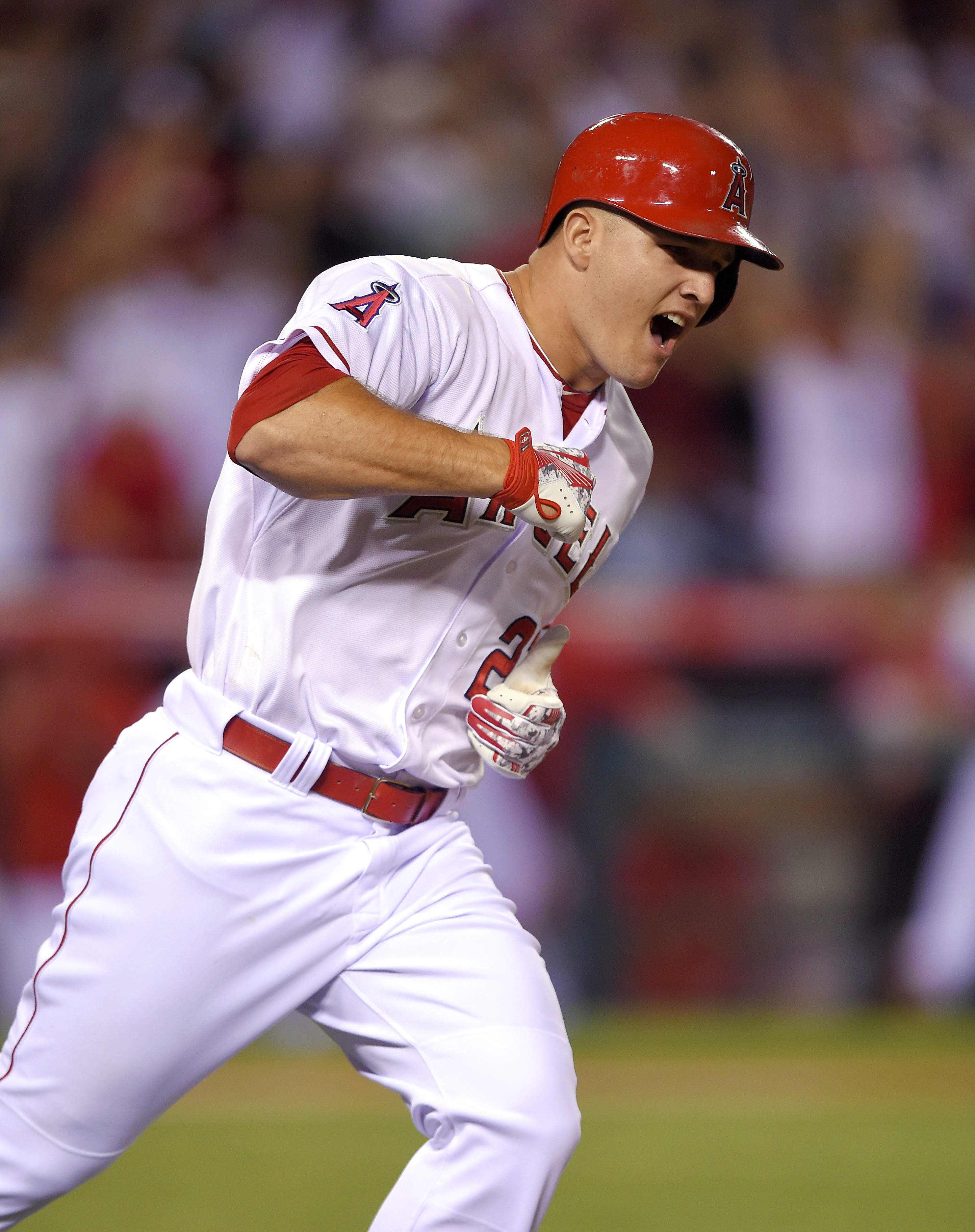 Los Angeles Angels' Mike Trout celebrates as he rounds first after hitting a solo home run during the ninth inning of a baseball game against the Boston Red Sox, Friday, July 17, 2015, in Anaheim, Calif. The Angels won 1-0. (AP Photo/Mark J. Terrill)