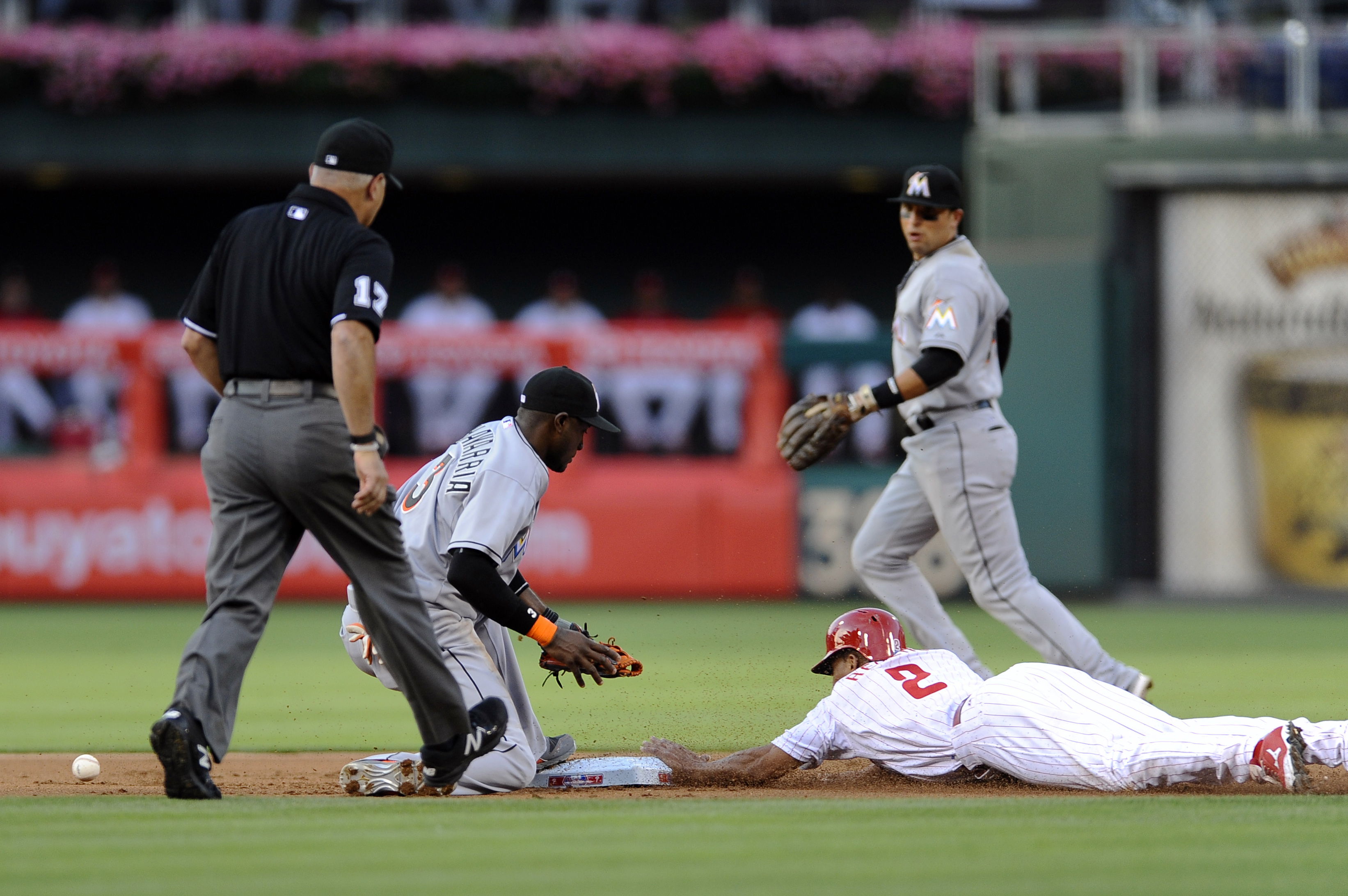 Philadelphia Phillies' Ben Revere (2) steals second base in front of Miami Marlins shortstop Adeiny Hechavarria who can't handle the throw during the first inning of a baseball game, Saturday, July 18, 2015, in Philadelphia. (AP Photo/Michael Perez)