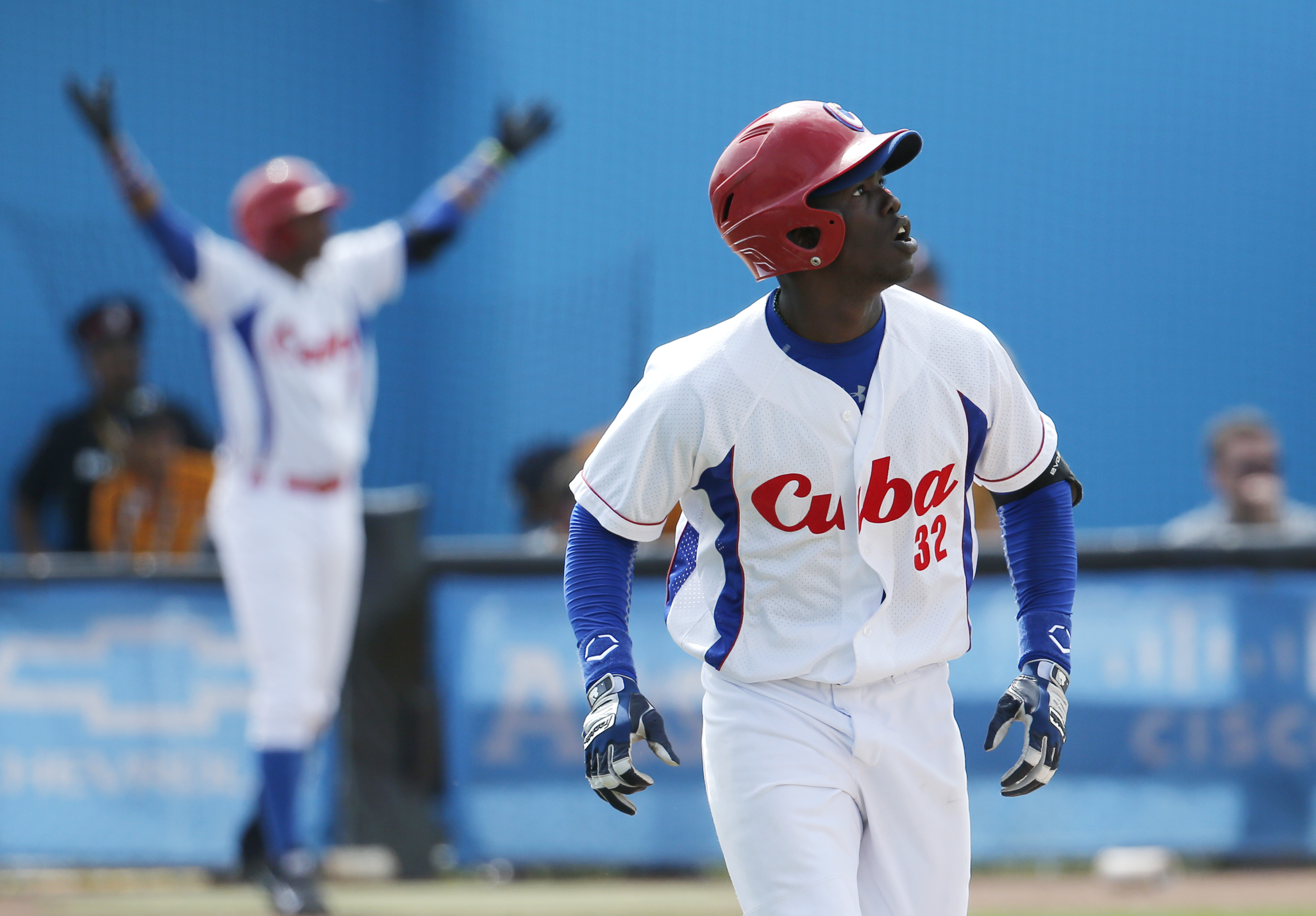 Cuba's Jose Garcia watches his ball while hitting a walk off home run off Puerto Rico pitcher Raul Rivera in the ninth inning of the bronze medal baseball game at the Pan Am Games, Sunday, July 19, 2015, in Ajax, Ontario. Cuba won 7-6. (AP Photo/Julio Cor