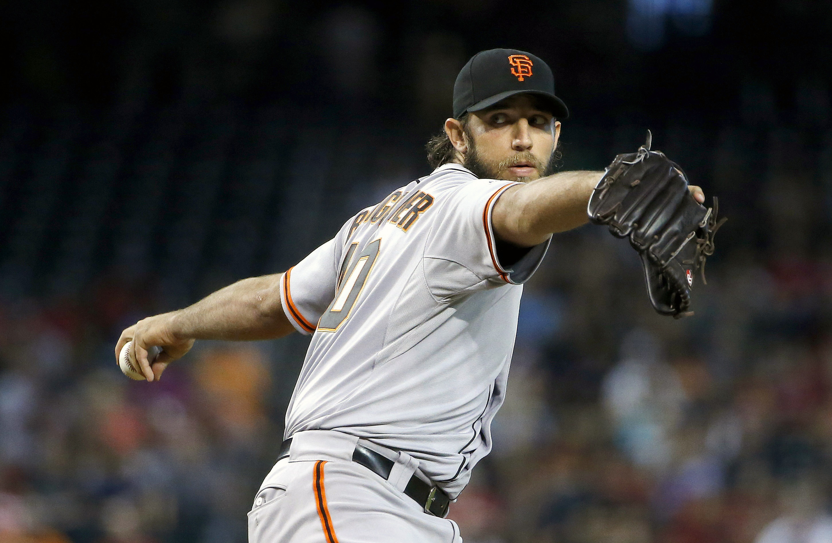 San Francisco Giants' Madison Bumgarner throws a pitch against the Arizona Diamondbacks during the first inning of a baseball game Sunday, July 19, 2015, in Phoenix. (AP Photo/Ross D. Franklin)