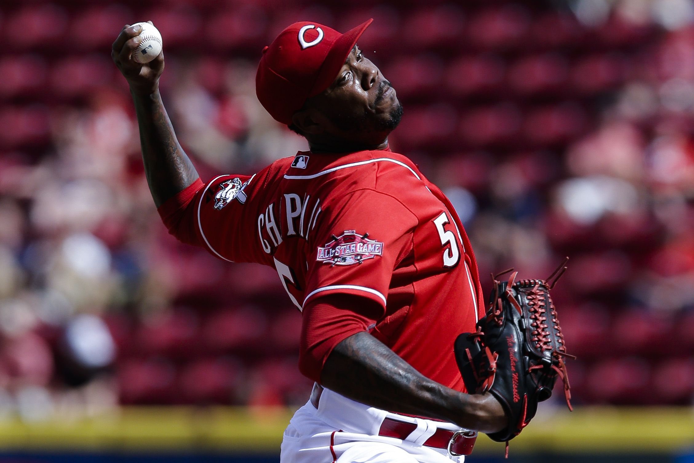 Cincinnati Reds relief pitcher Aroldis Chapman throws in the ninth inning of a baseball game against the Cleveland Indians, Sunday, July 19, 2015, in Cincinnati. (AP Photo/John Minchillo)