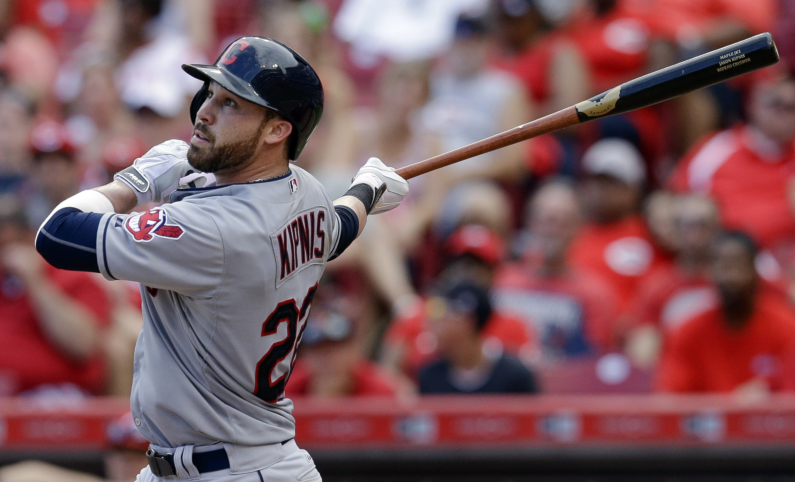 Cleveland Indians' Jason Kipnis hits a sacrifice fly off Cincinnati Reds relief pitcher Pedro Villarreal to drive in Michael Bourn in the eleventh inning of a baseball game, Sunday, July 19, 2015, in Cincinnati. The Indians won 5-3. (AP Photo/John Minchil