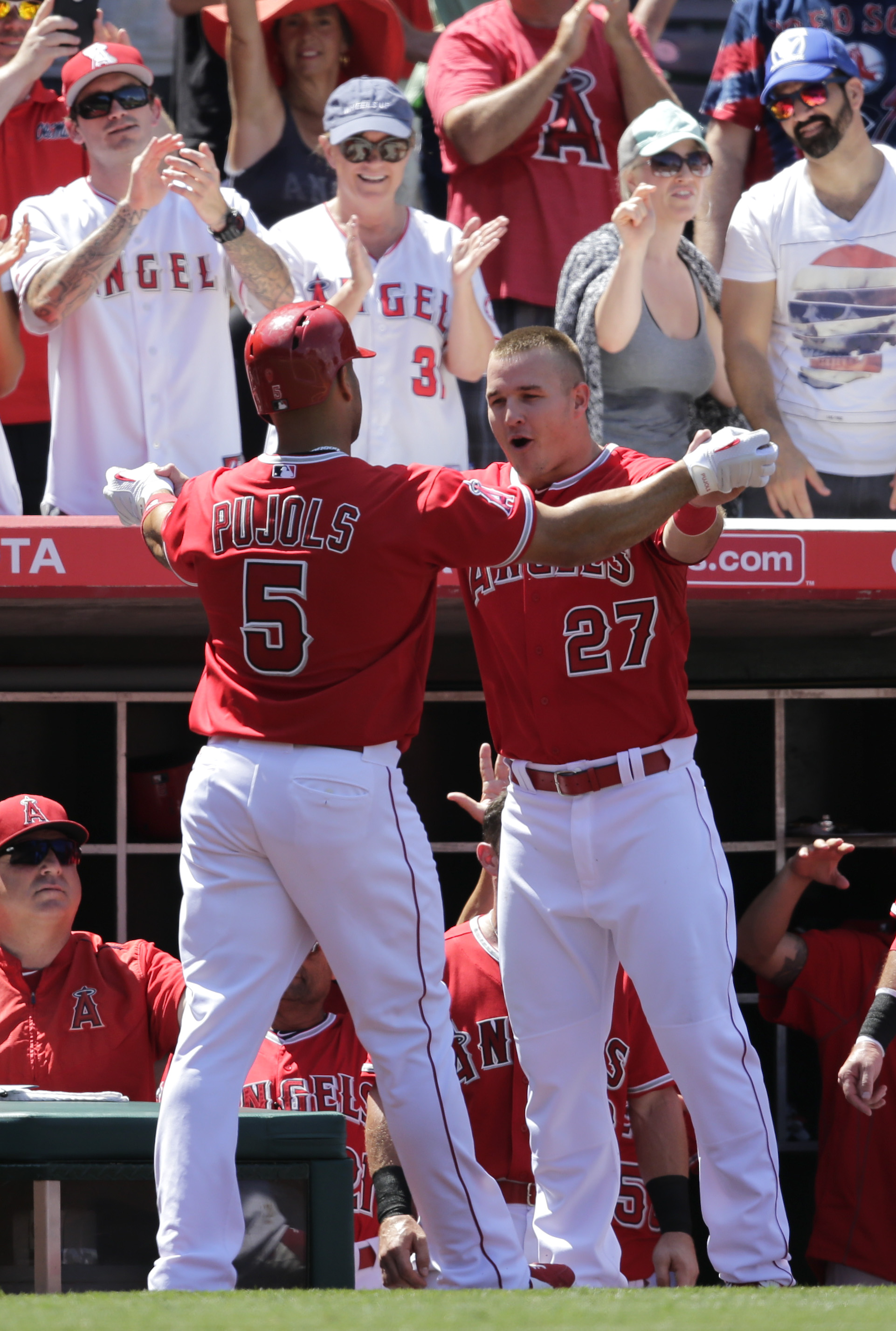 Los Angeles Angels' Albert Pujols, left, celebrates his home run with Mike Trout during the second inning of a baseball game against the Boston Red Sox, Monday, July 20, 2015, in Anaheim, Calif. (AP Photo/Jae C. Hong)