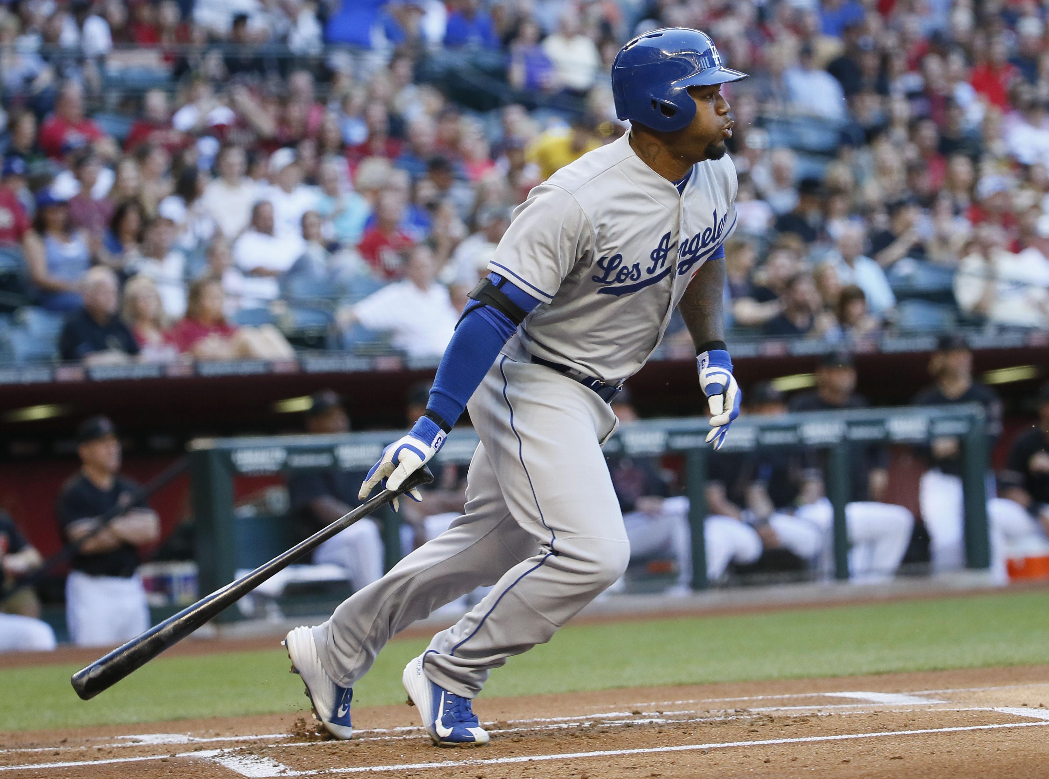 Los Angeles Dodgers Carl Crawford hits against the Arizona Diamondbacks during the first inning of a MLB baseball game, Saturday, April 11, 2015, in Phoenix. (AP Photo/Matt York)