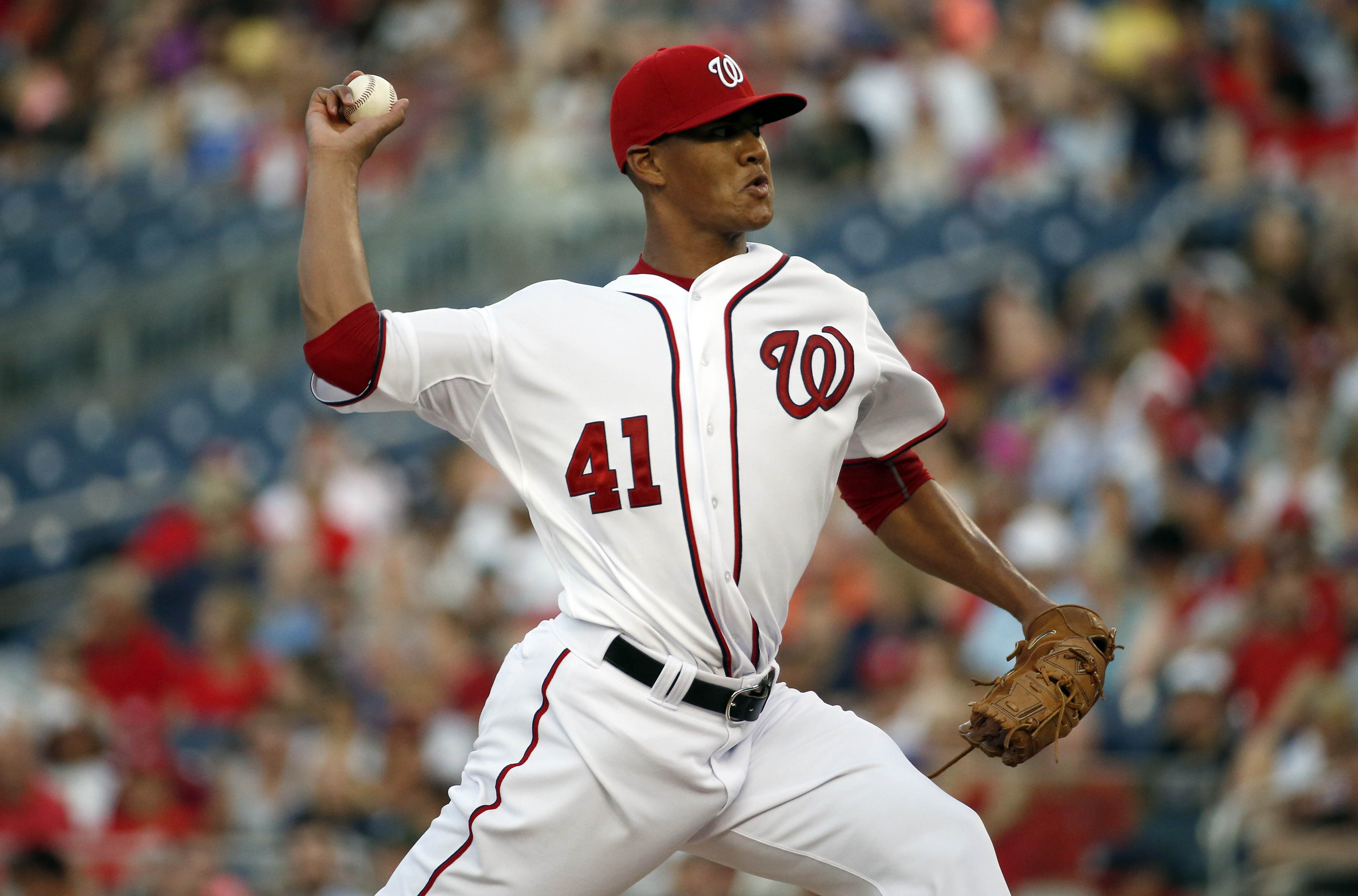 Washington Nationals starting pitcher Joe Ross throws during the third inning of a baseball game against the New York Mets at Nationals Park, Tuesday, July 21, 2015, in Washington. (AP Photo/Alex Brandon)