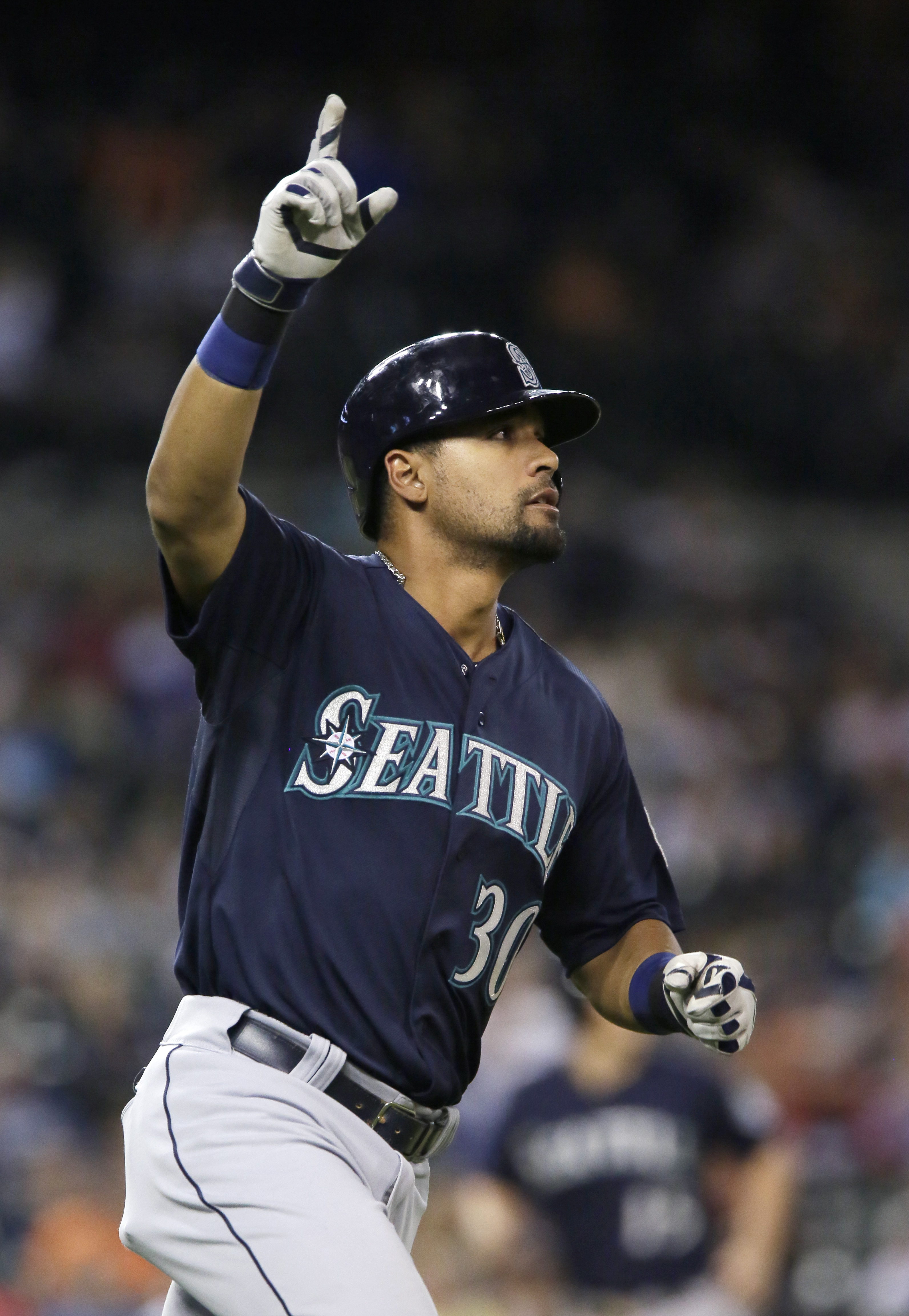 Seattle Mariners' Franklin Gutierrez celebrates as his hit clears the right field wall for a grand slam home run during the eighth inning of a baseball game against the Detroit Tigers Tuesday, July 21, 2015 in Detroit. (AP Photo/Duane Burleson)