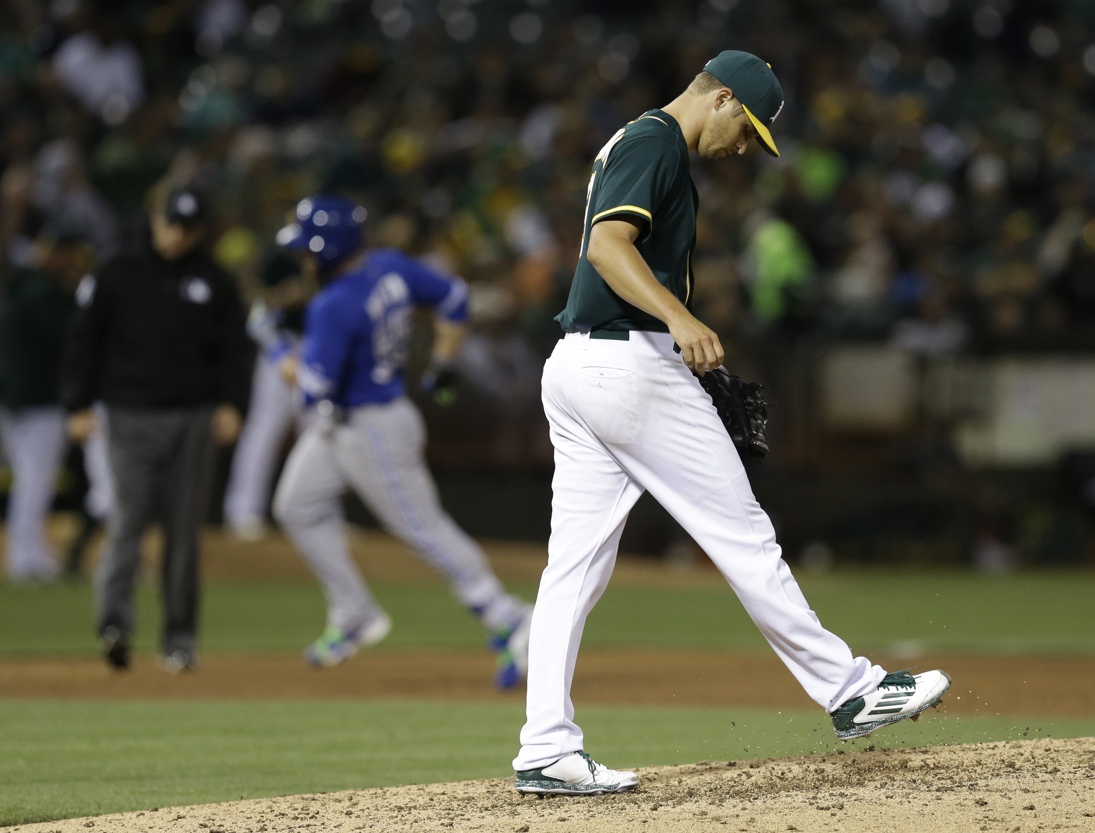 Oakland Athletics' Kendall Graveman kicks the mound after giving up a three-run home run to Toronto Blue Jays' Russell Martin during the sixth inning of a baseball game Tuesday, July 21, 2015, in Oakland, Calif. (AP Photo/Ben Margot)
