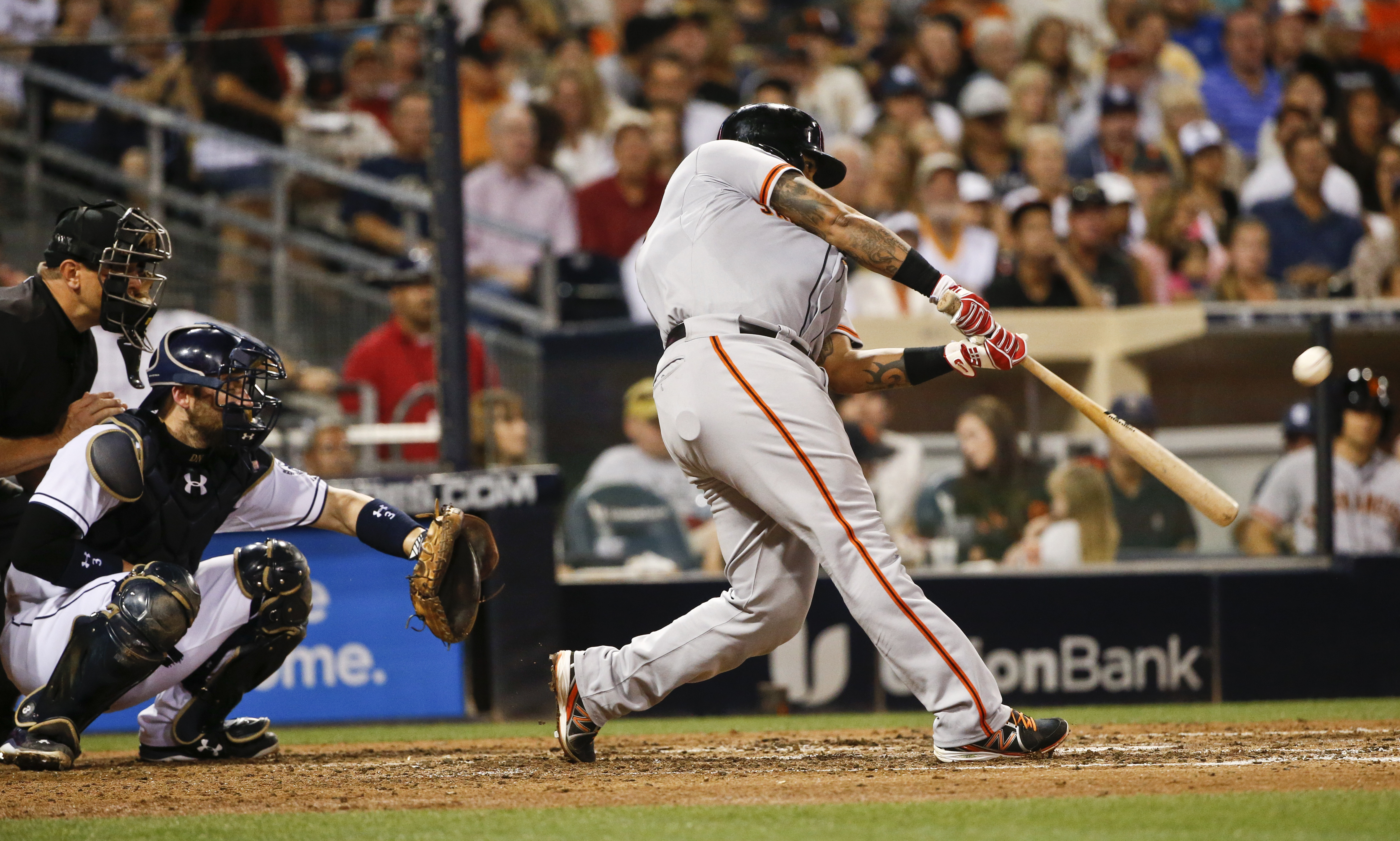 San Francisco Giants' Hector Sanchez swings on a grand slam against the San Diego Padres during the sixth inning of a baseball game Tuesday, July 21, 2015, in San Diego. The Padres had intentionally walked Gregor Blanco to pitch to Sanchez. (AP Photo/Lenn