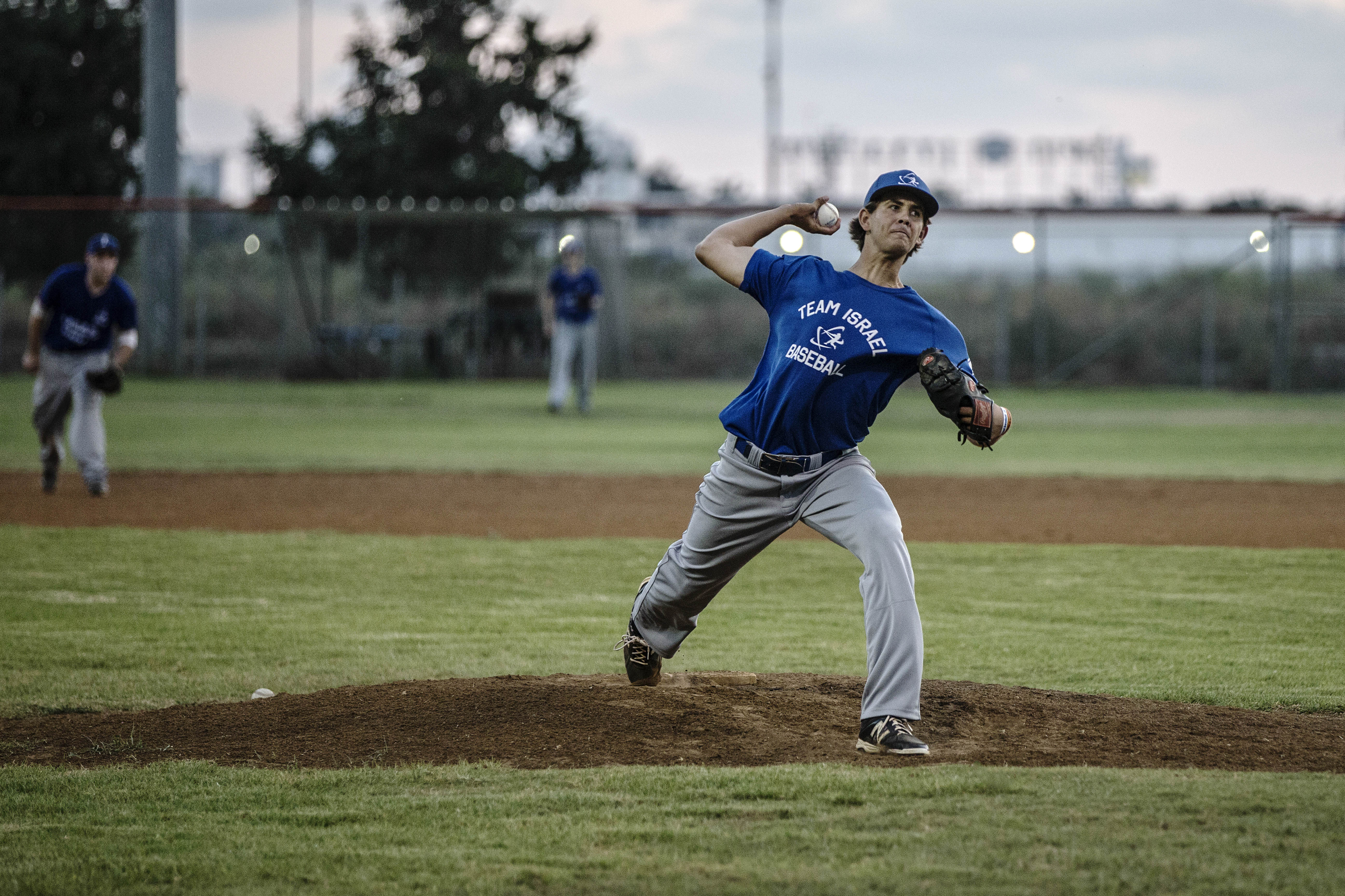 In this Monday, July 20, 2015 photo, Israel baseball team pitcher Dean Kremer pitches during training near the city of Petah Tikva, Israel. The 6-foot-2 Kremer is the golden boy of Israeli baseball, the first citizen to be selected in the major league dra