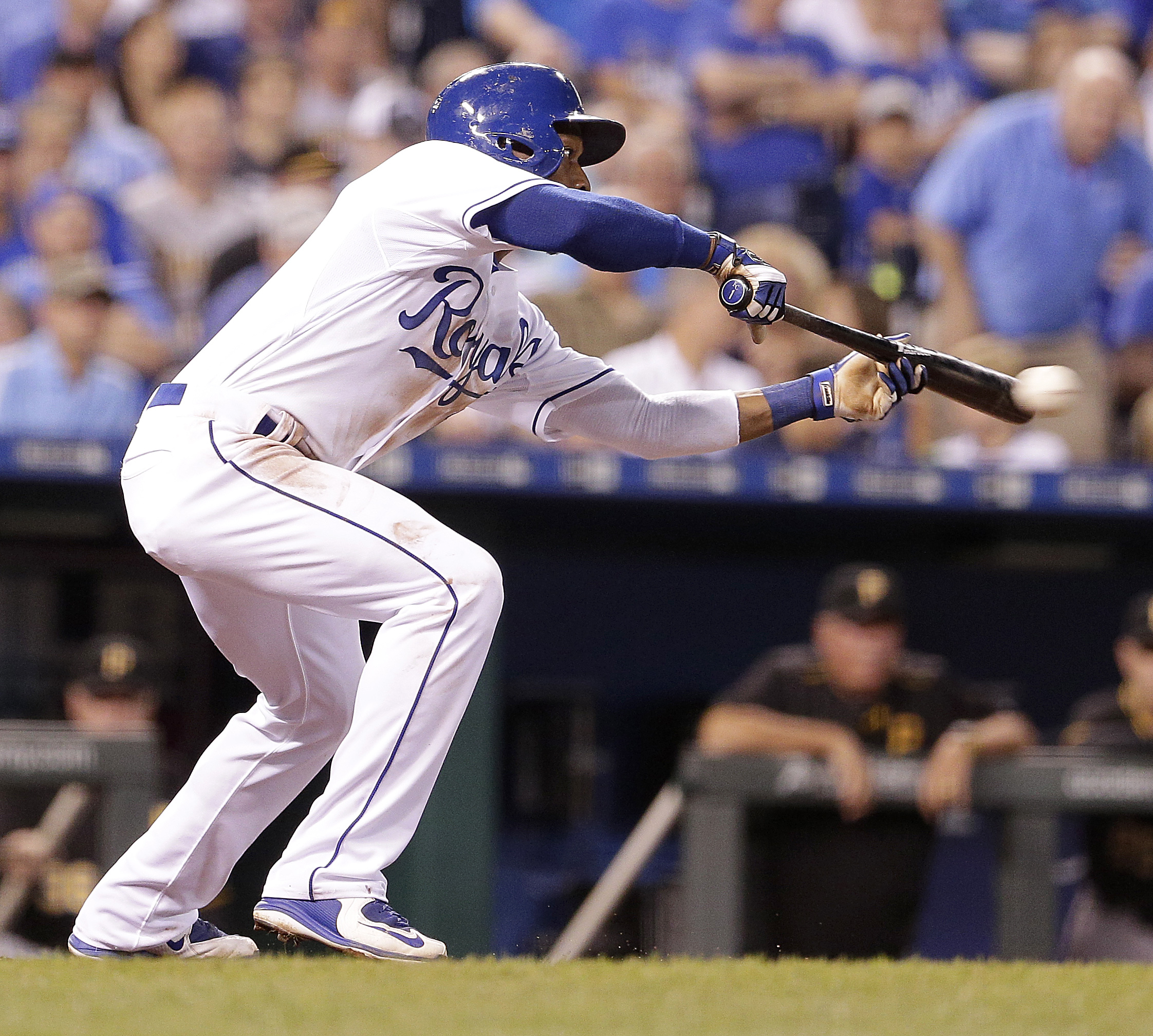 Kansas City Royals' Jarrod Dyson hits a bunt single to score Omar Infante during the seventh inning of a baseball game against the Pittsburgh Pirates Wednesday, July 22, 2015, in Kansas City, Mo. (AP Photo/Charlie Riedel)